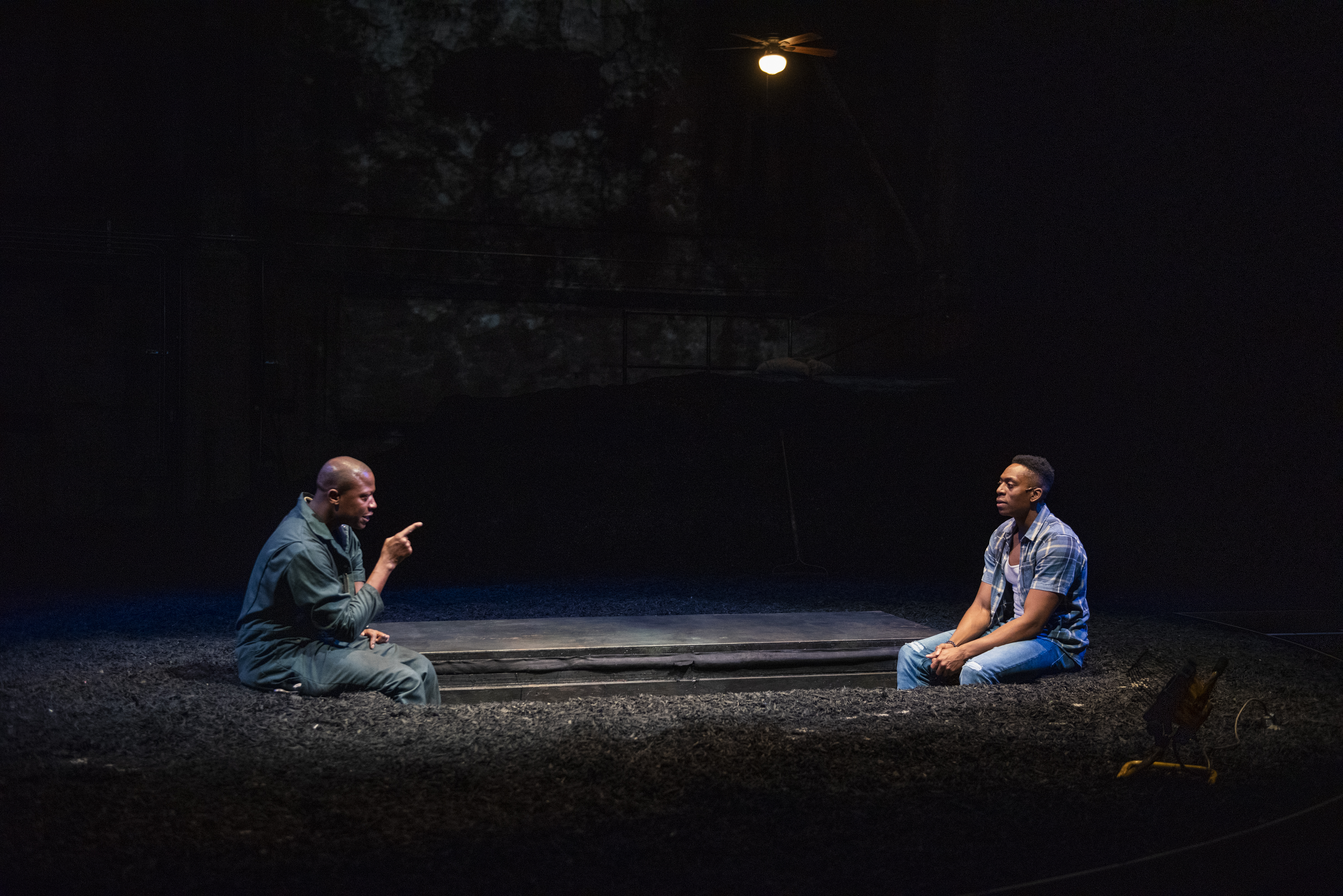 "Manny Buckley (left) as Ogun Size and Patrick Agada as Oshoosi Size in a scene from the Steppenwolf for Young Adults' production of ""TheBrothers Size"" by ensemble member Tarell Alvin McCraney and directed by Monty Cole."