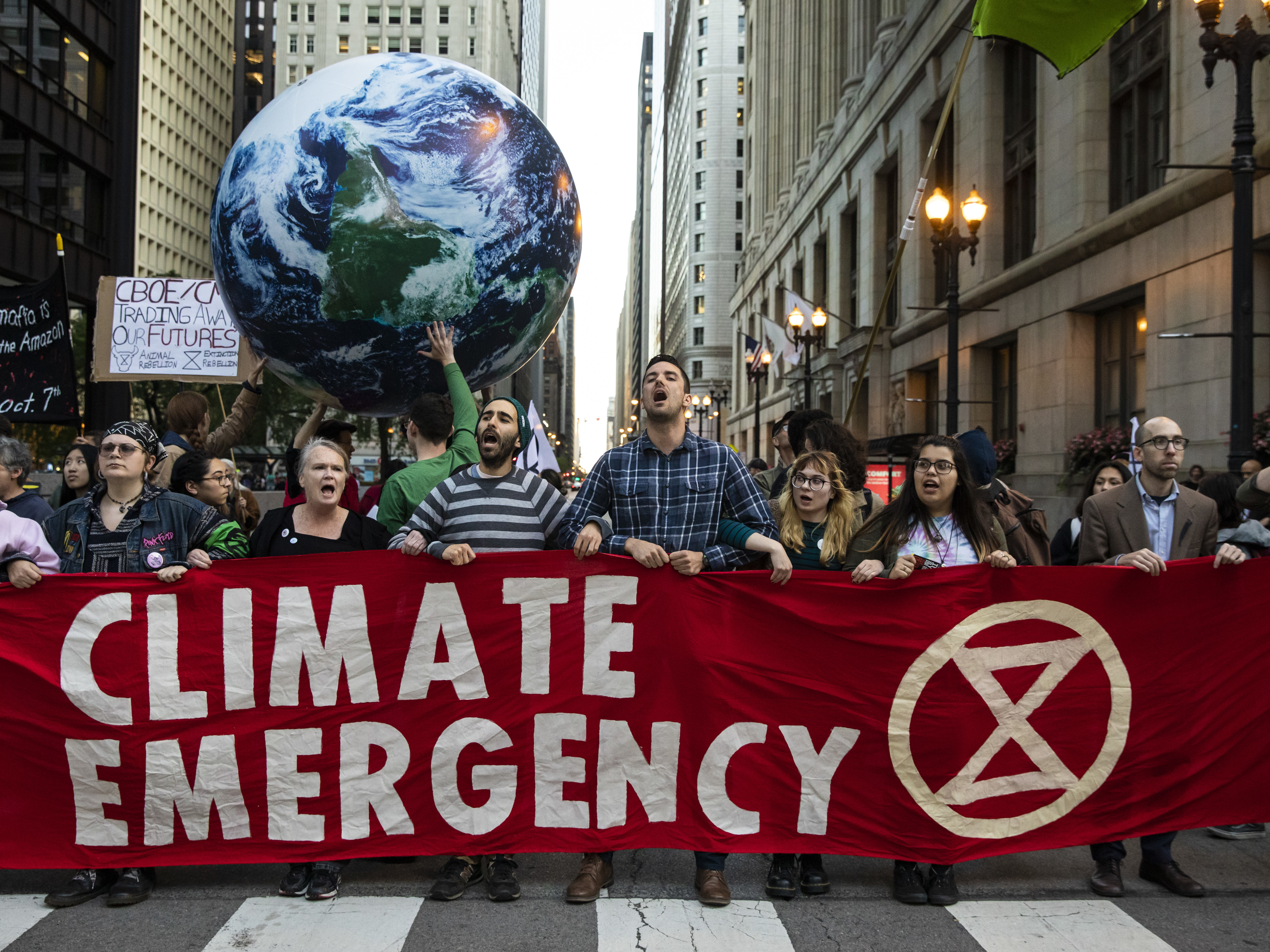 Climate change protesters block traffic and march through the Loop, urging government action to thwart the consequences of global warming, Monday evening, Oct. 7, 2019.