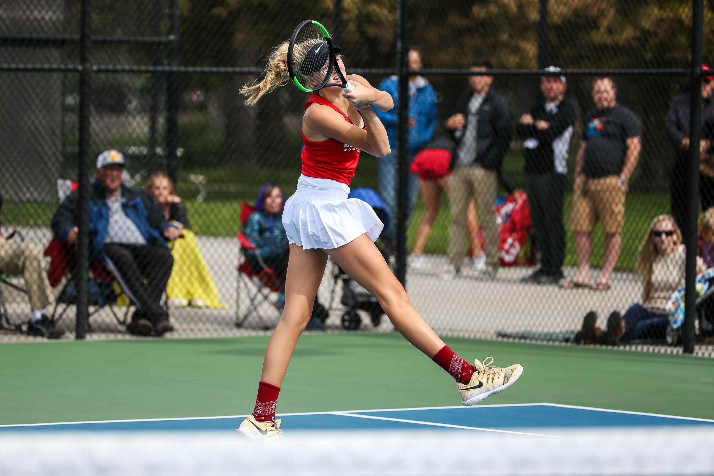 East's Emmie Moore competes in the No. 1 singles championship match against Alta's Emilee Astle during the 5A state tennis tournament at the Liberty Park Tennis Center in Salt Lake City on Saturday, Oct. 6, 2018.
