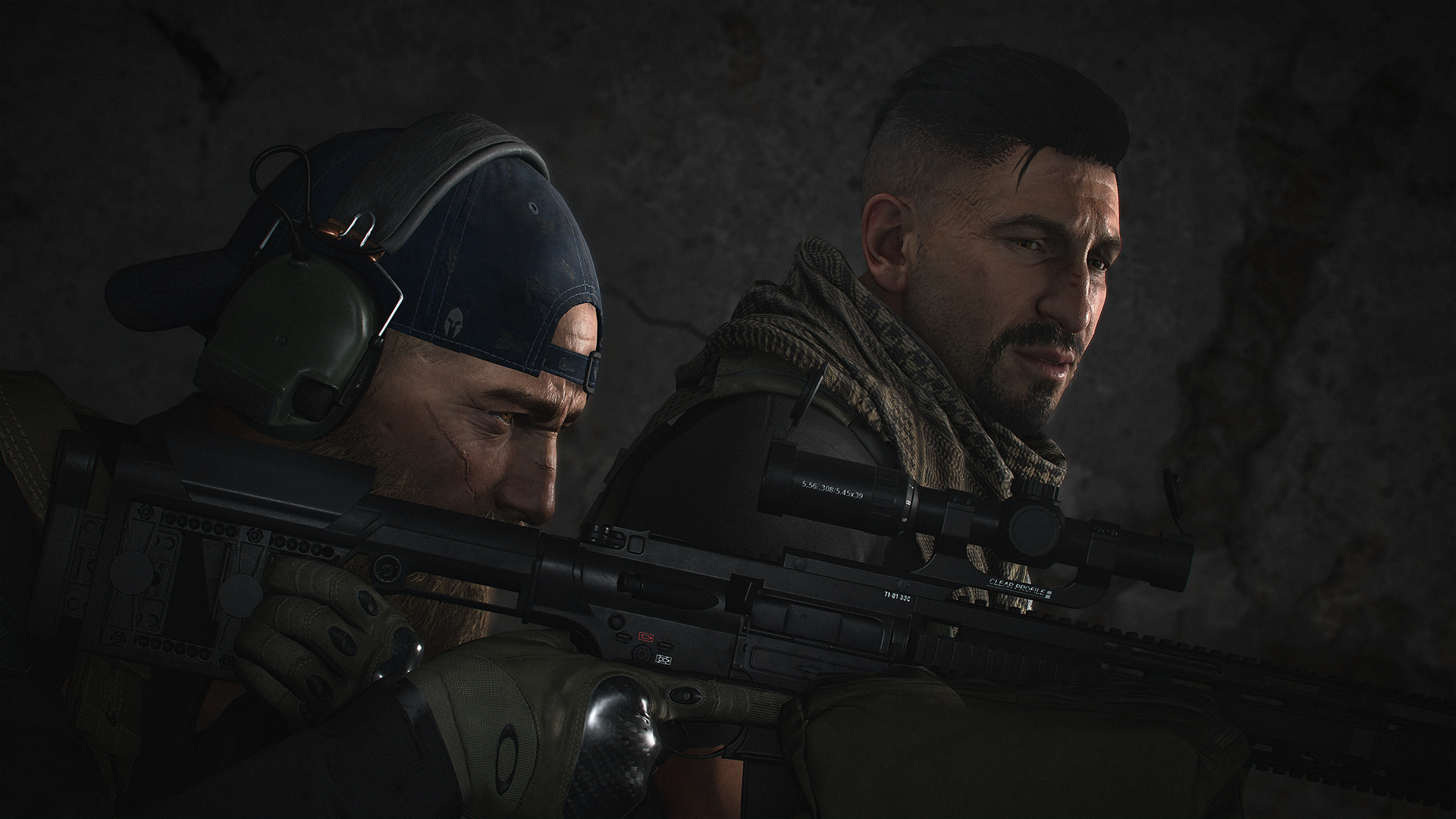 Two grizzled Ghost Recon operators side by side looking out at what is undoubtedly a grim scene of danger