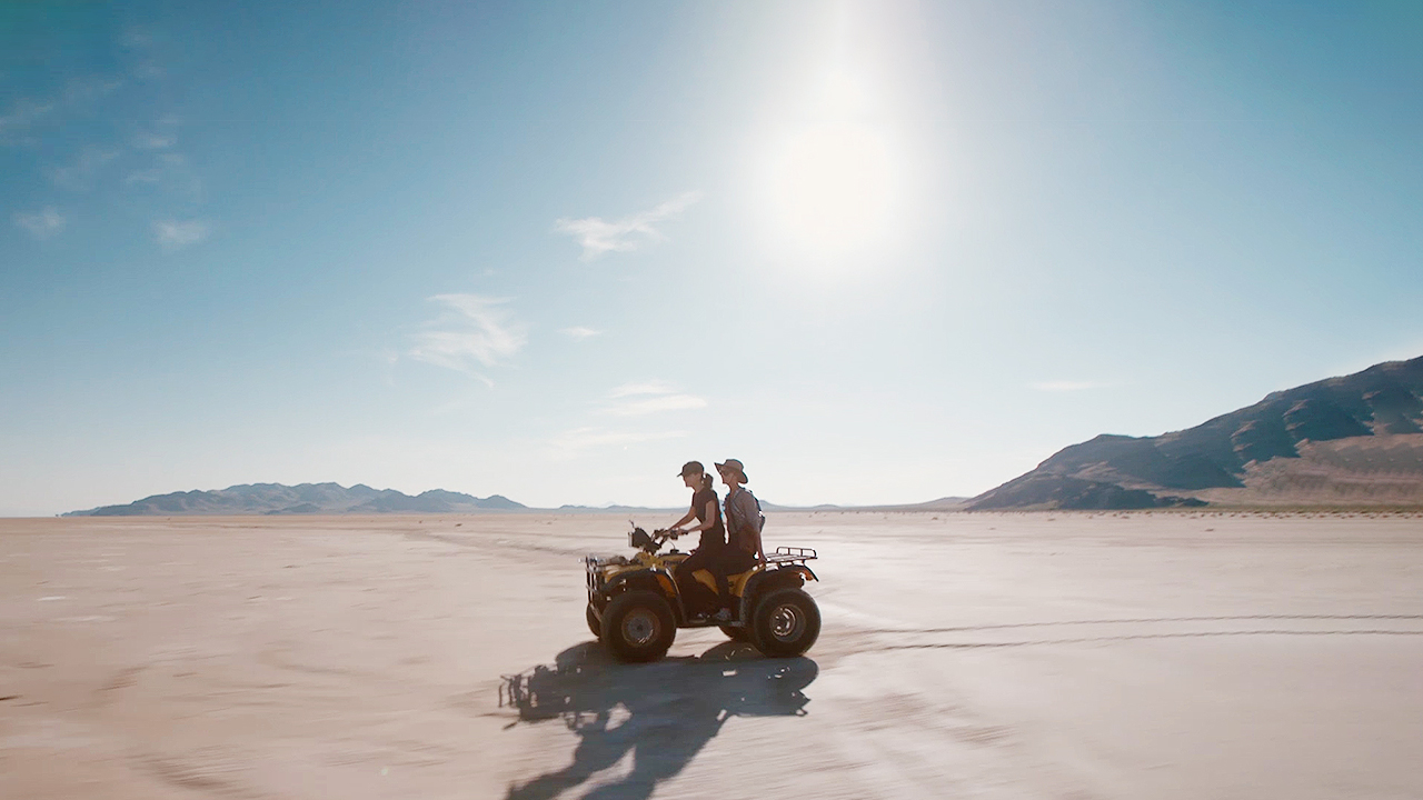 Cleo rides on an ATV across the salt flats in Utah