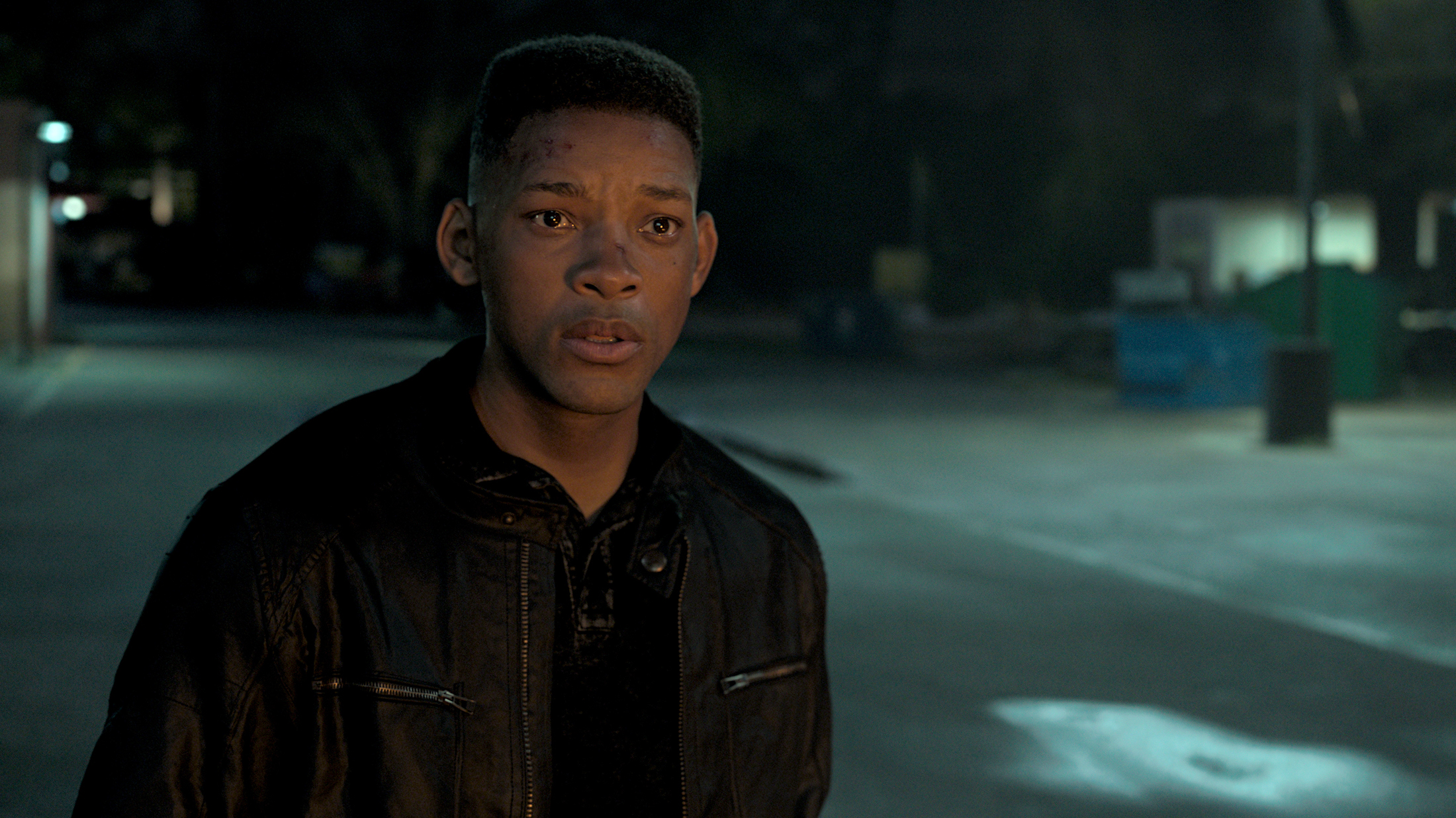 junior (a digital version of young will smith) stands mouth agape at an offscreen explosion