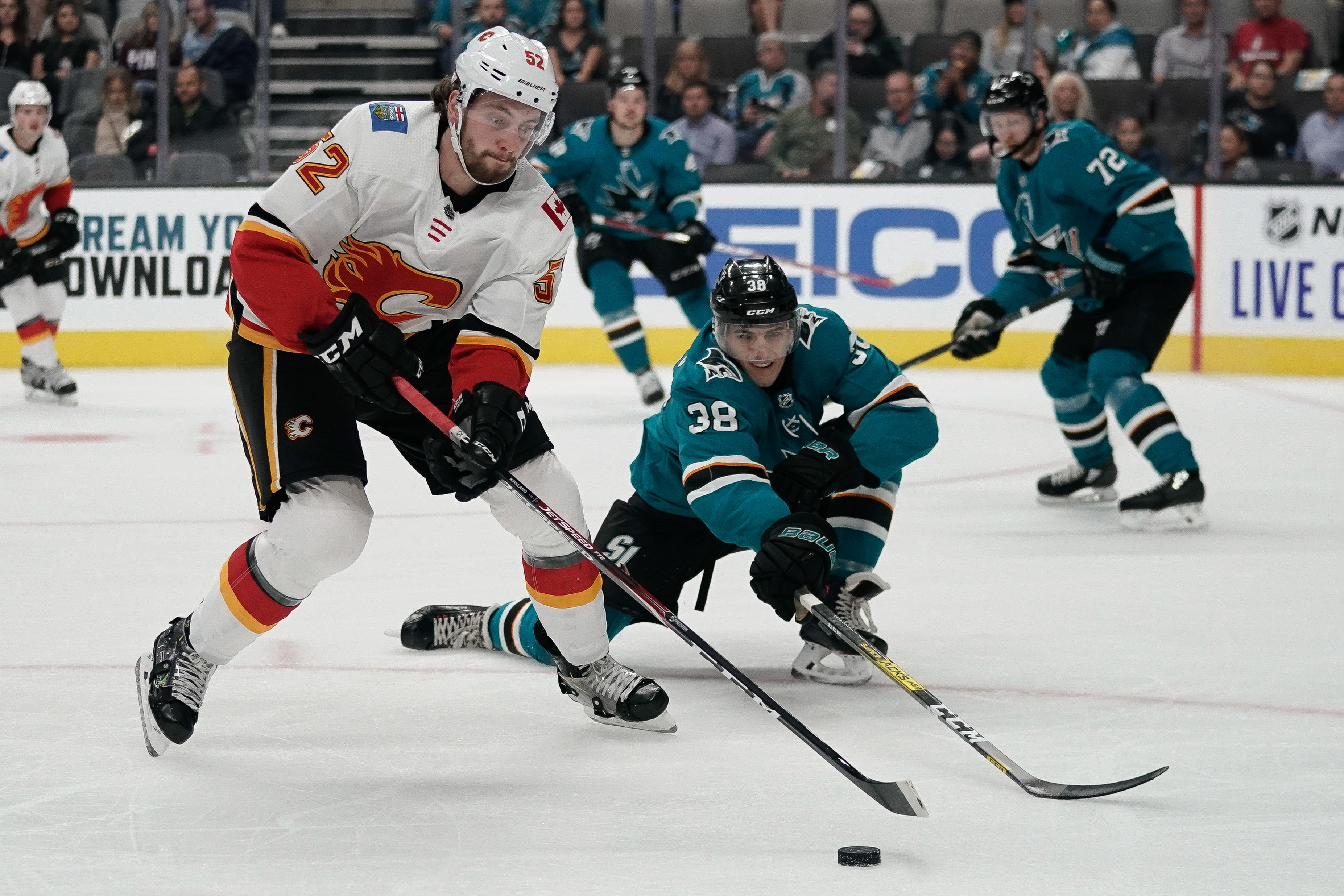 Sep 26, 2019; San Jose, CA, USA; San Jose Sharks defenseman Mario Ferraro (38) defends against Calgary Flames left wing Justin Kirkland (52) during the first period at the SAP Center at San Jose. Mandatory Credit: Stan Szeto