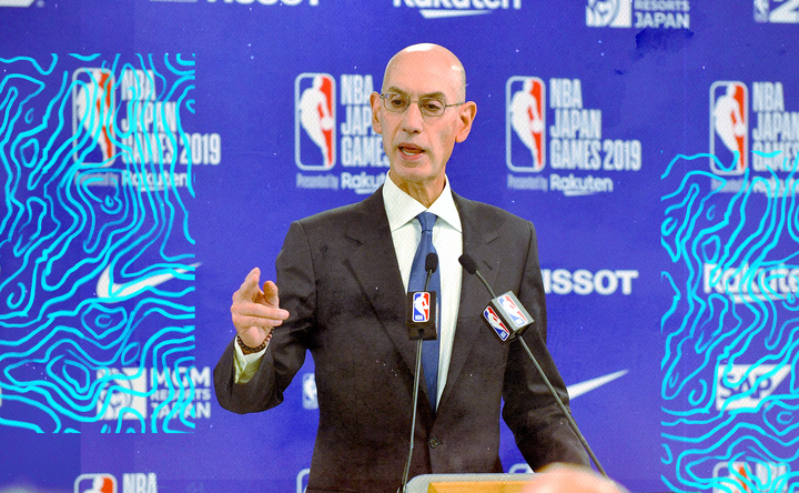 Adam Silver points to an audience member at a press conference.