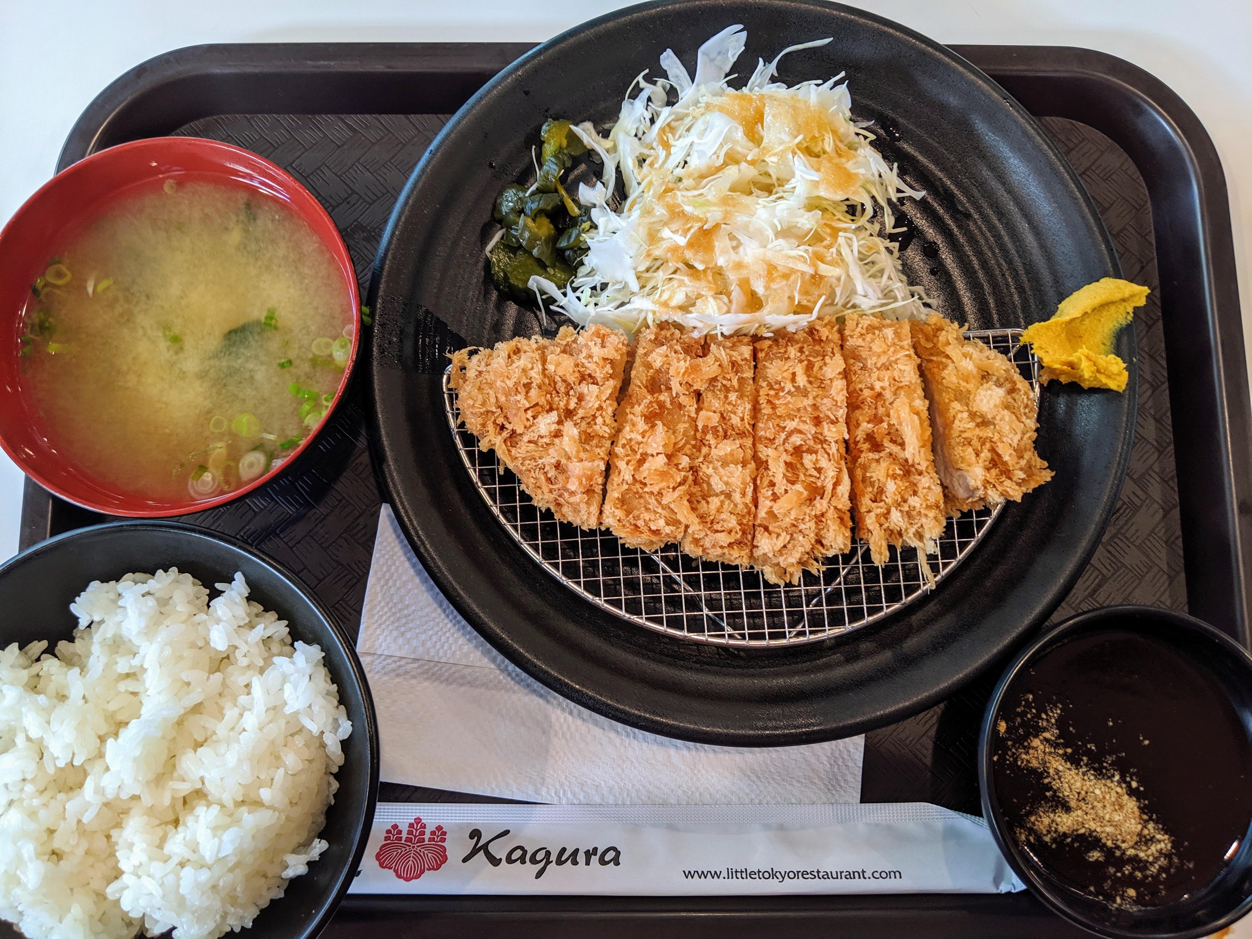 Tonkatsu set at Kagura Gardena with fried pork, steamed rice, and miso soup on a plastic tray.