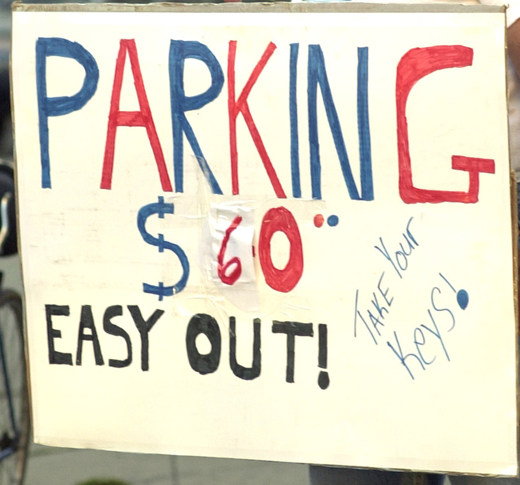 A sign advertising off-street parking for a Chicago Cubs game at Wrigley Field.