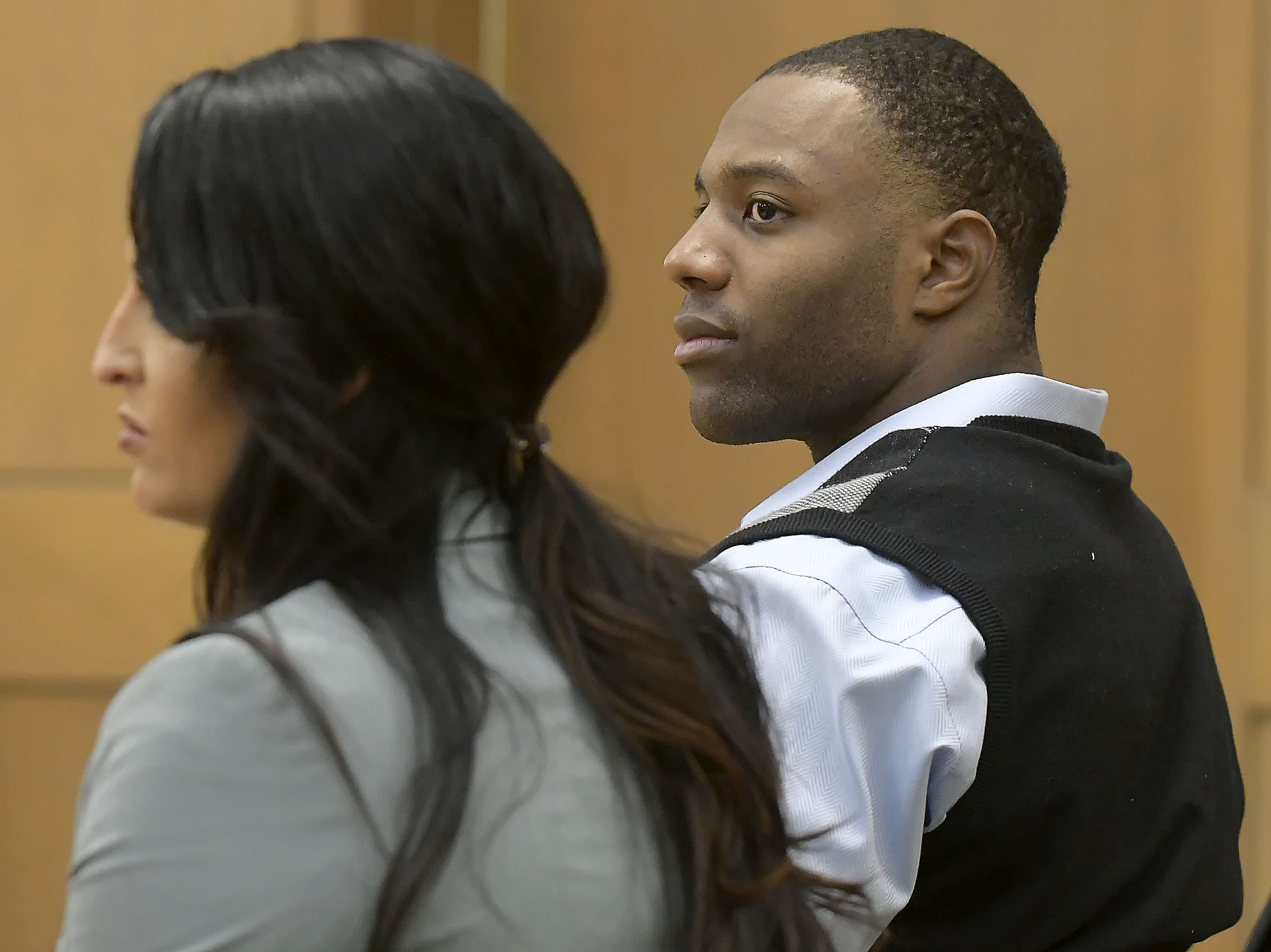 Torrey Green and his lawyer, Skye Lazaro, listen on Wednesday, Jan. 16, 2019, as a 1st District judge announces closing arguments in Green's rape trial will be held on Thursday in Brigham City.