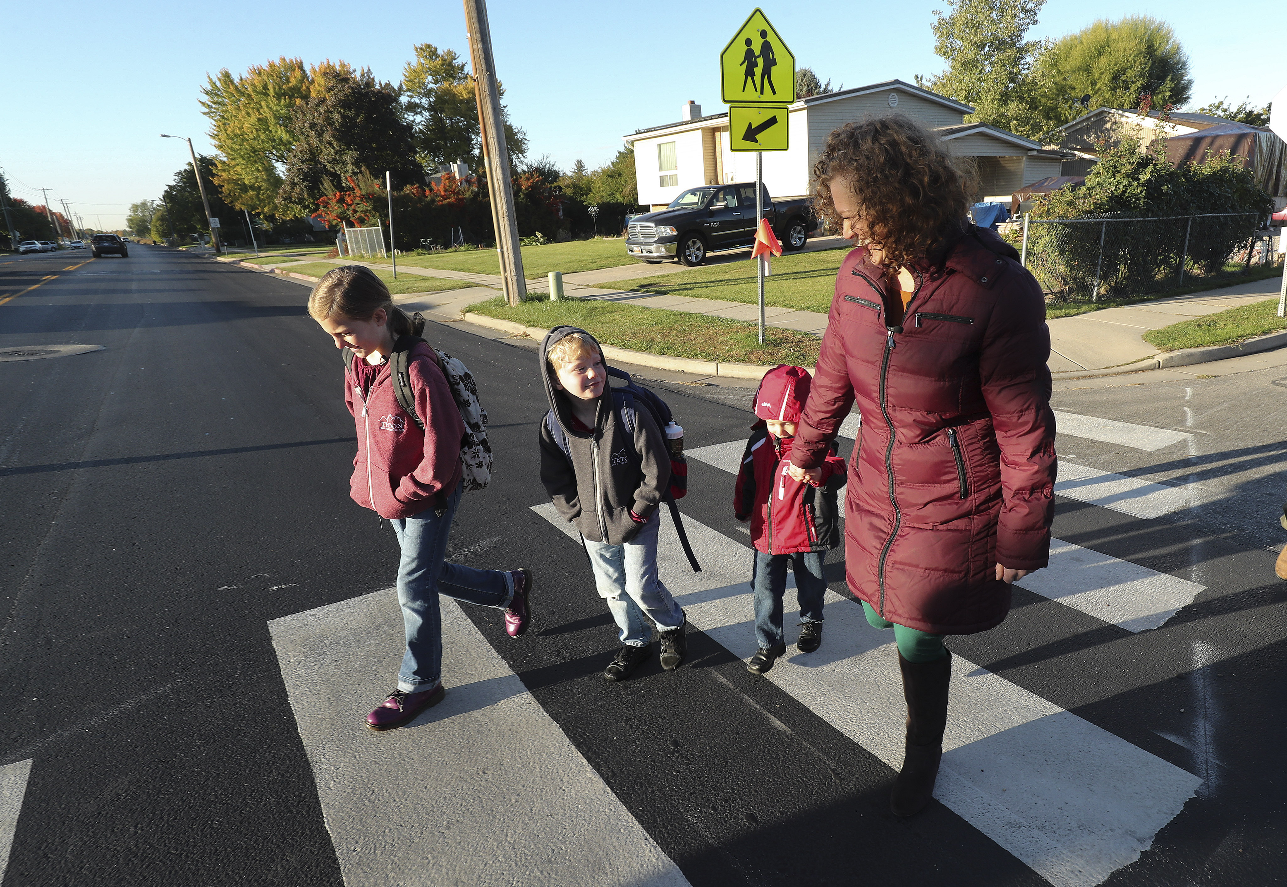 Trishelle Duncan walks her children, Abigail, 10, Luke, 6, and Nicholas, 3, to school in Kaysville on Tuesday, Oct. 8, 2019. The Duncan family has walked to and from school every day since Trishelle's epilepsy diagnosis. Duncan credits their improved family life to this simple act of walking.
