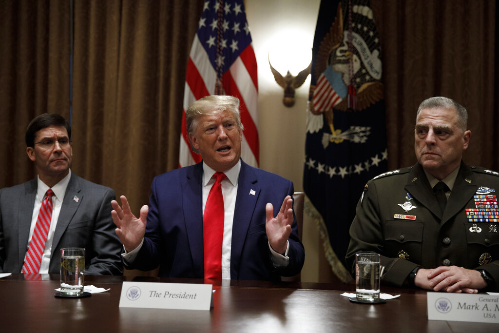 President Donald Trump, joined by from left, Defense Secretary Mark Esper, and Chairman of the Joint Chiefs of Staff Gen. Mark Milley, speaking in the Cabinet Room at the White House in Washington