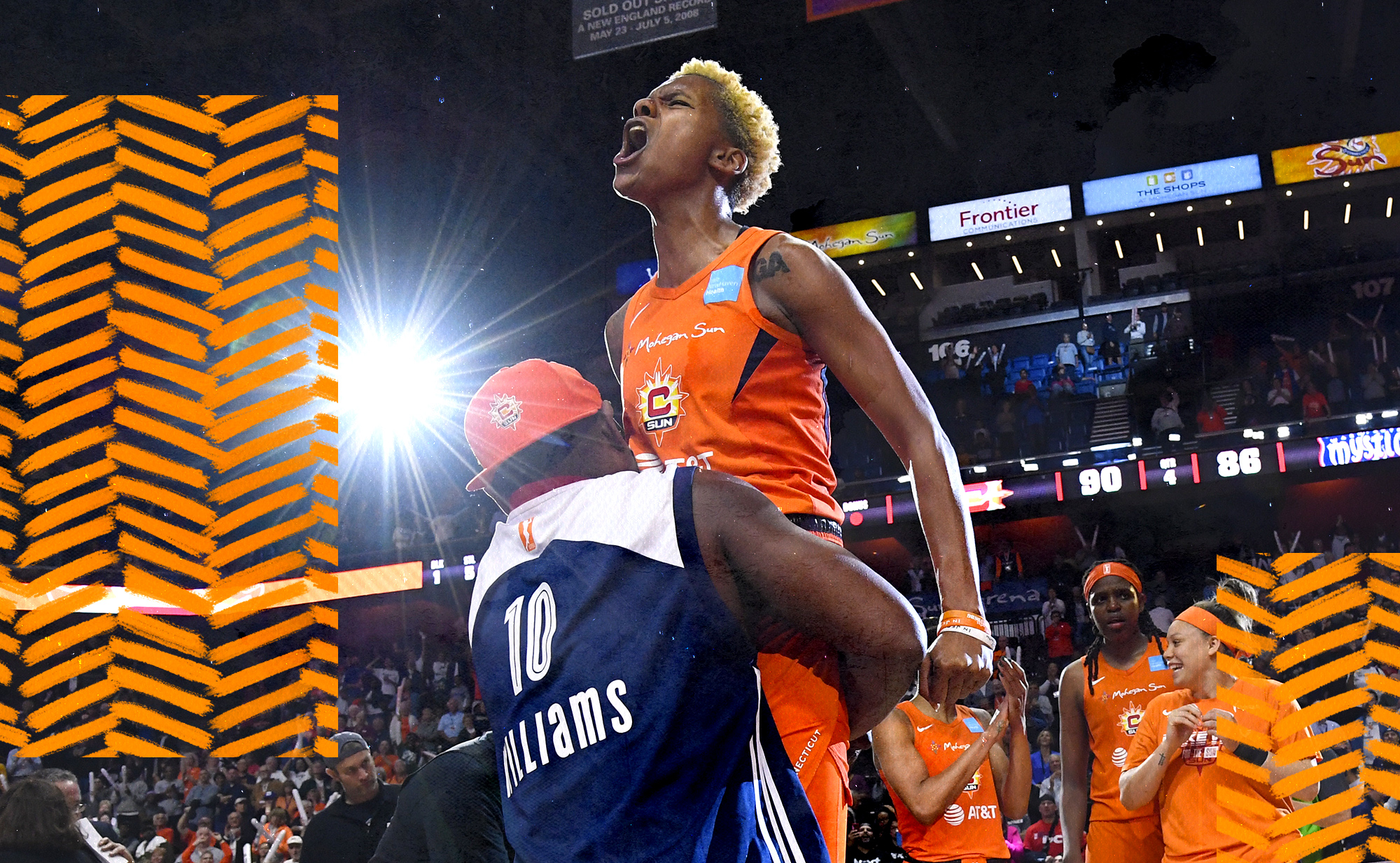 Sun star guard Courtney Williams is lifted up by her father after winning Game 4 of the WNBA Finals.