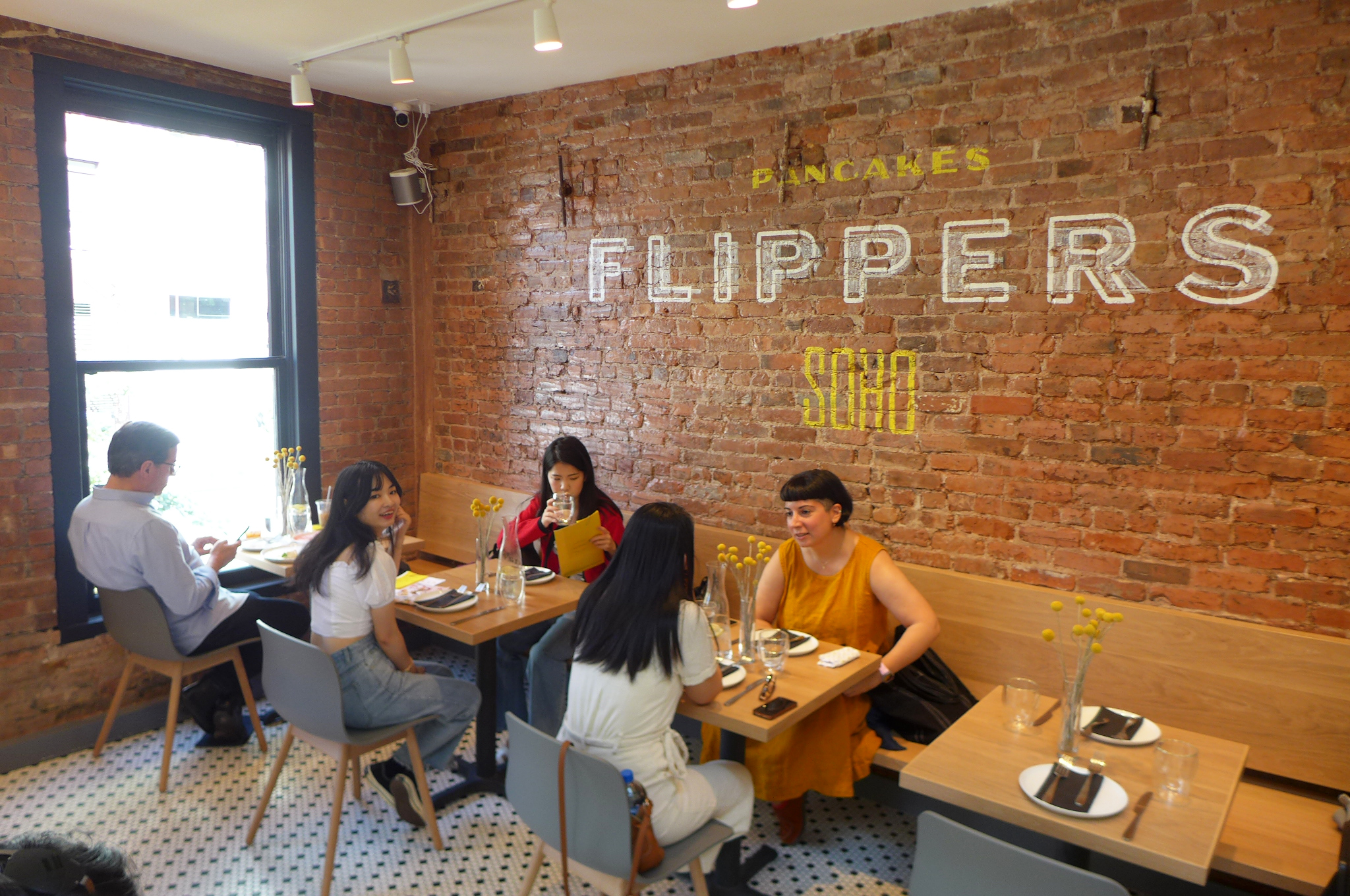 Japanese Chain Flipper's Pillowy Pancakes Delight, But Not Much Else Does