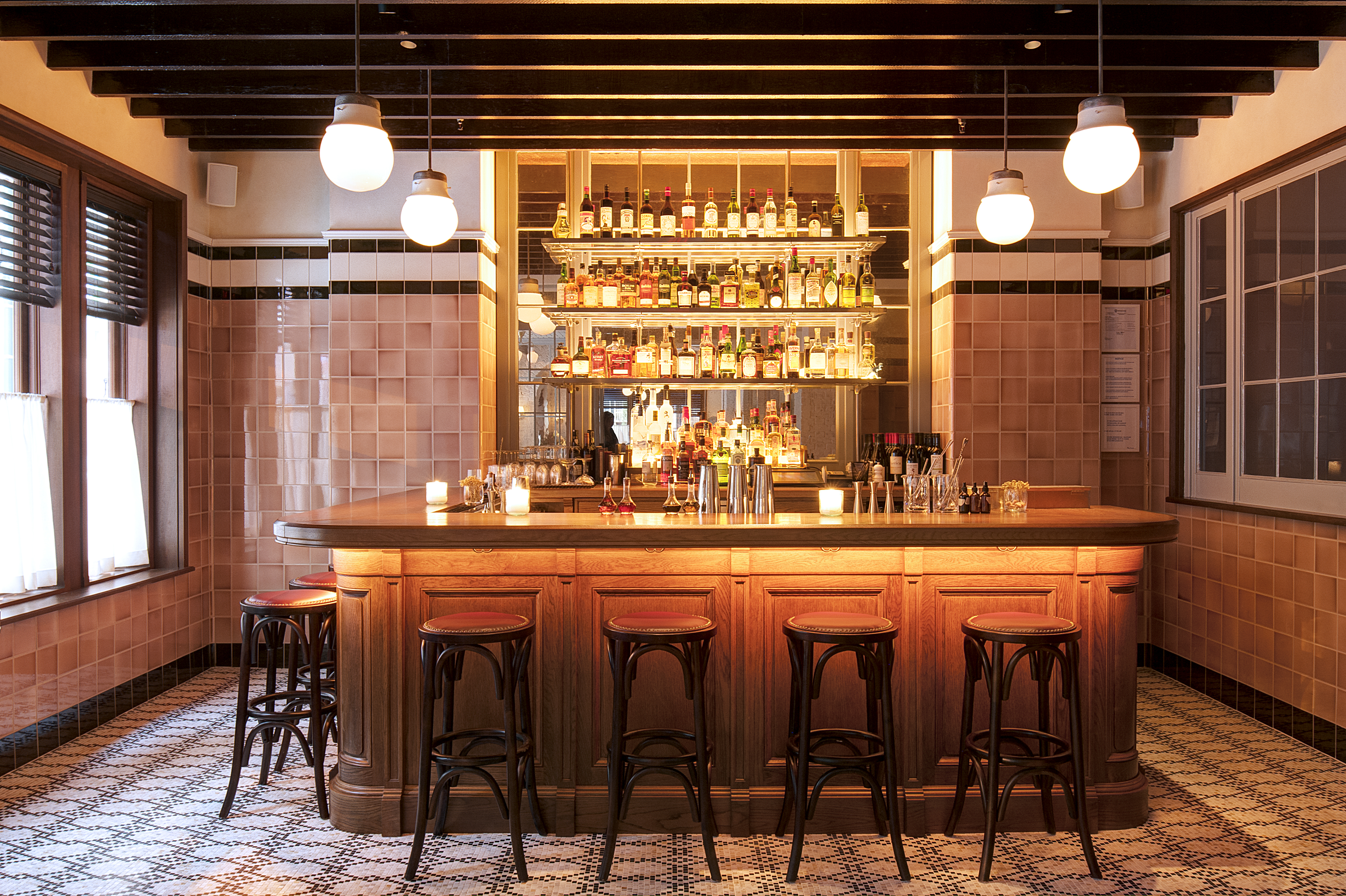 small bar with stools and globe lights above