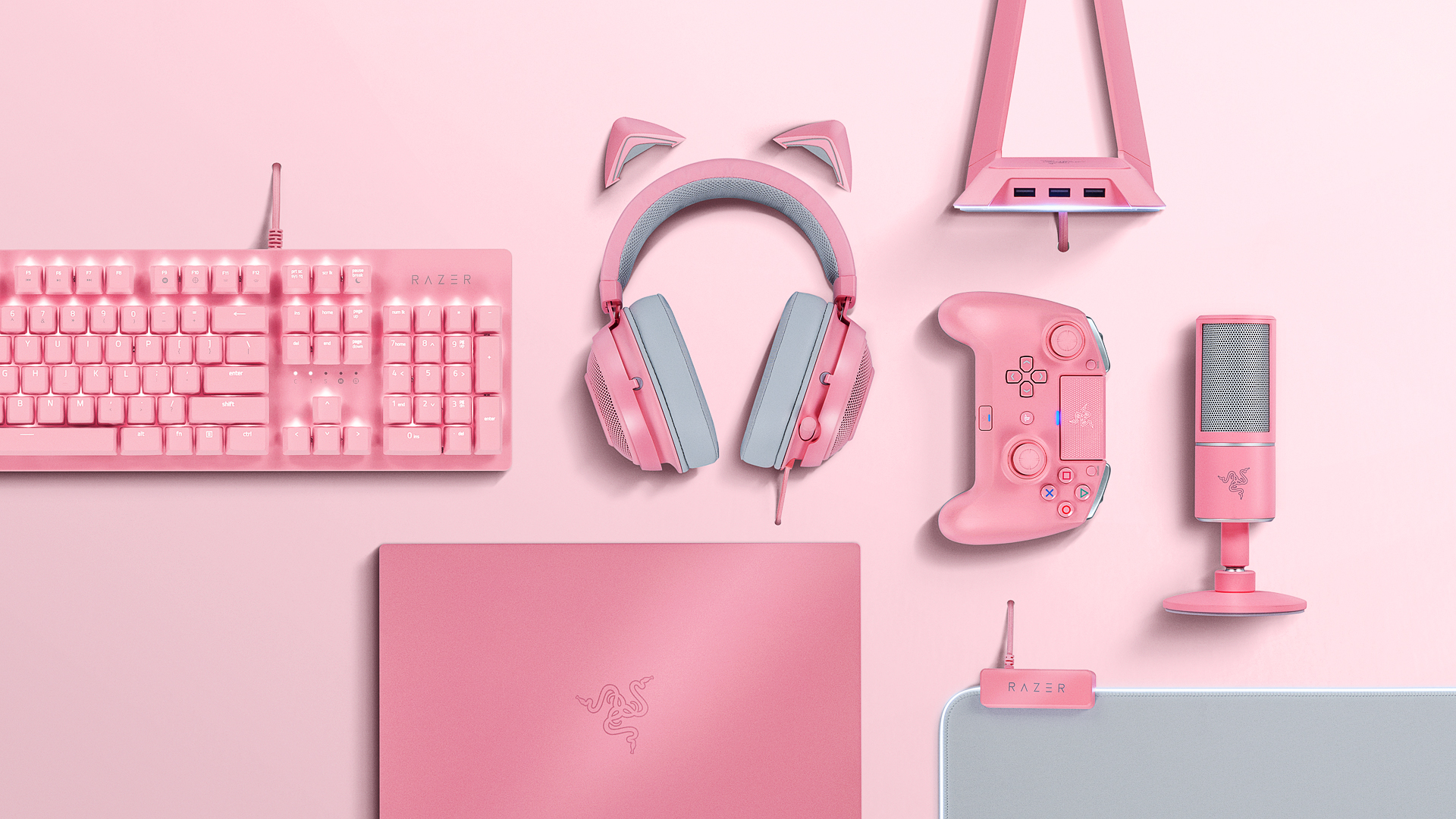 Pink keyboard, headphones, game controller and laptop made by Razer