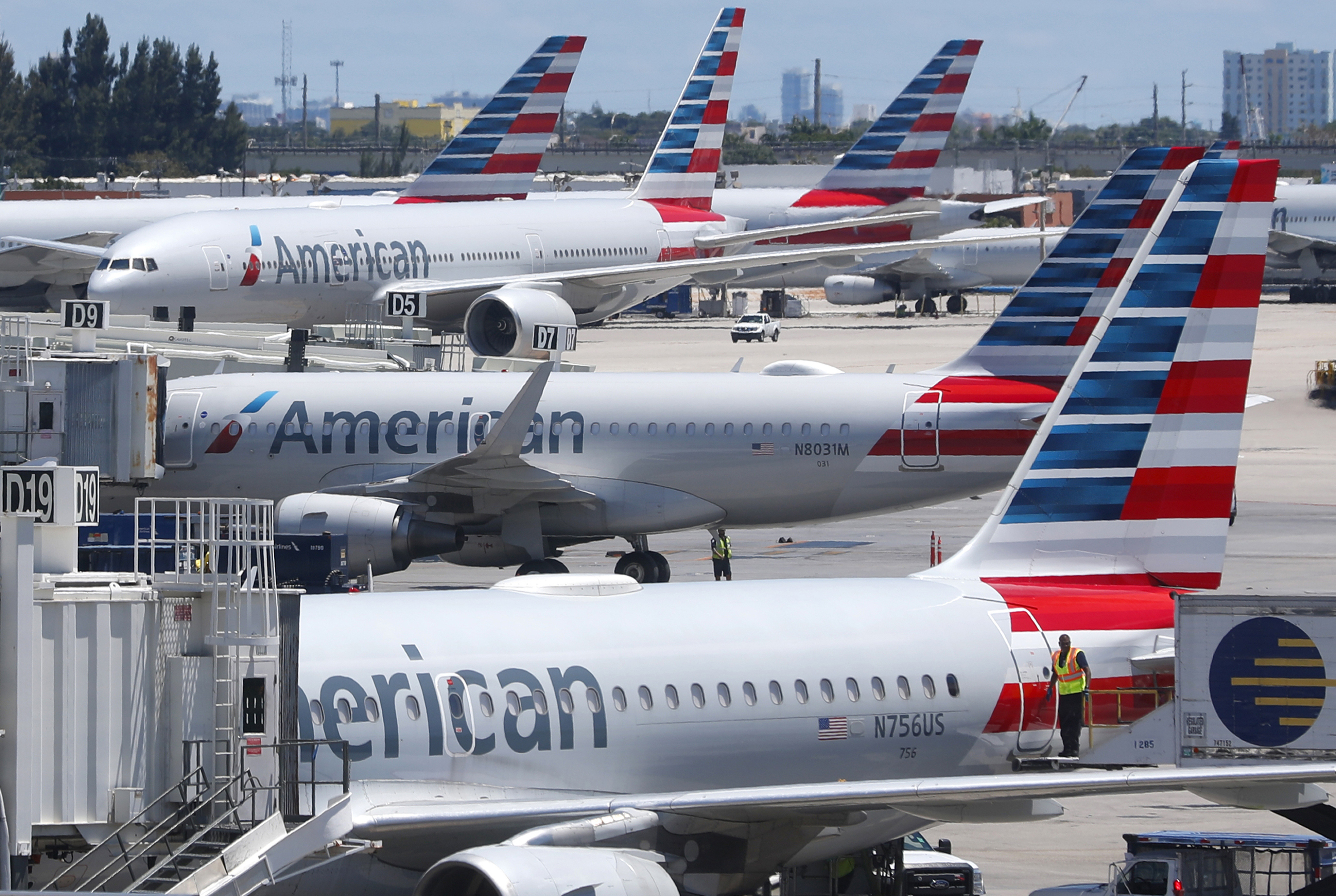 American Airlines aircraft are shown parked at their gates at Miami International Airport in Miami.