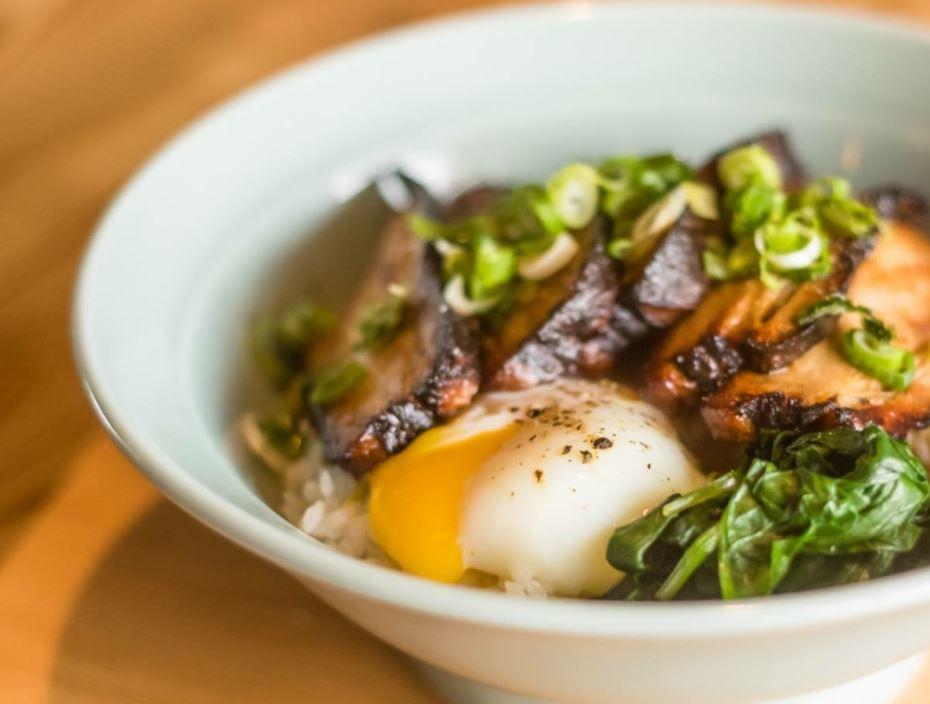 Bowl of ramen with sliced pork and soft boiled egg.