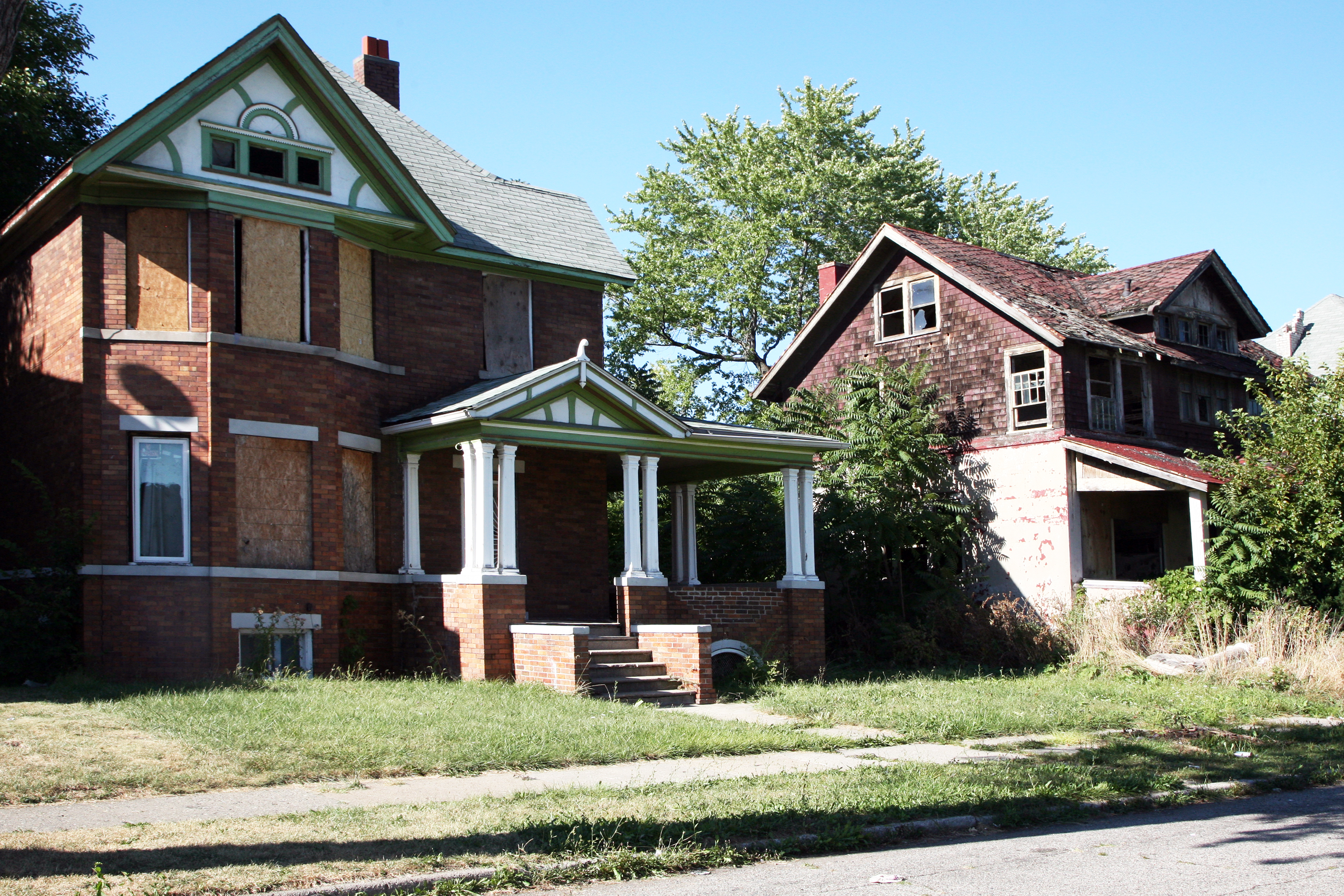 Two abandoned homes in Detroit.