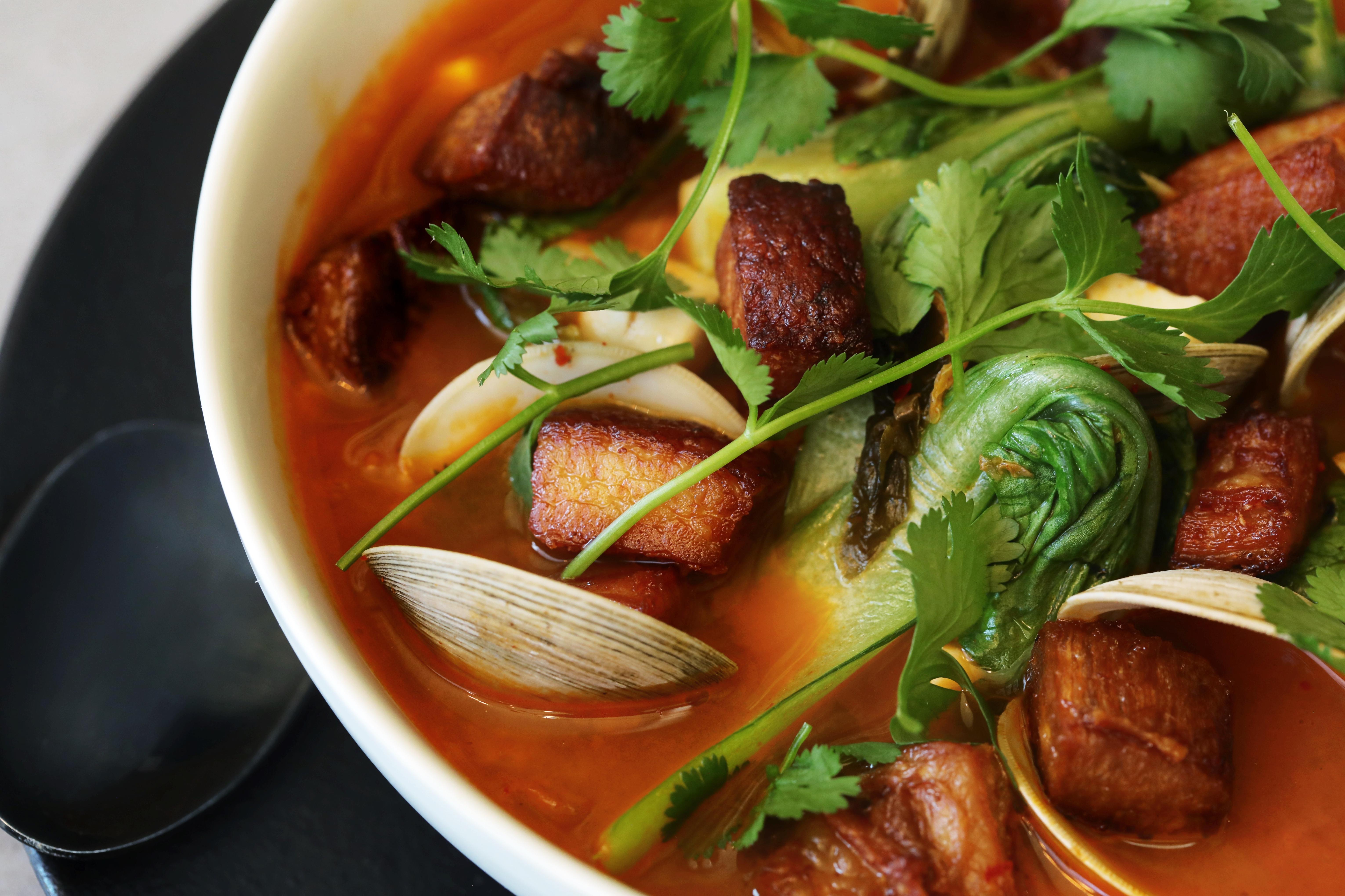 A bowl of pork belly kimchi stew.