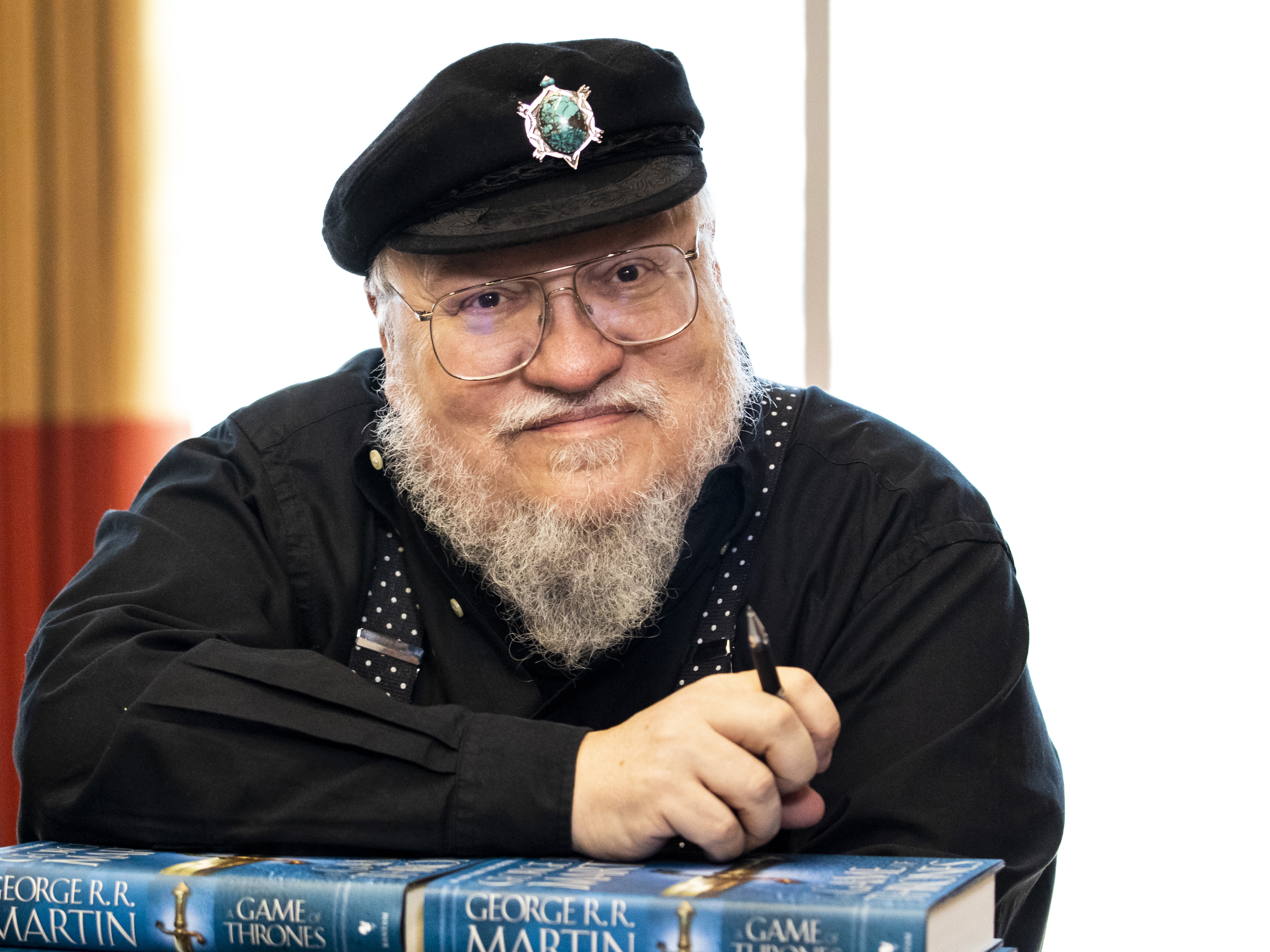 "Author George R. R. Martin prepares to sign copies of his novel ""A Game of Thrones"" Wednesday at a River North Hotel. 