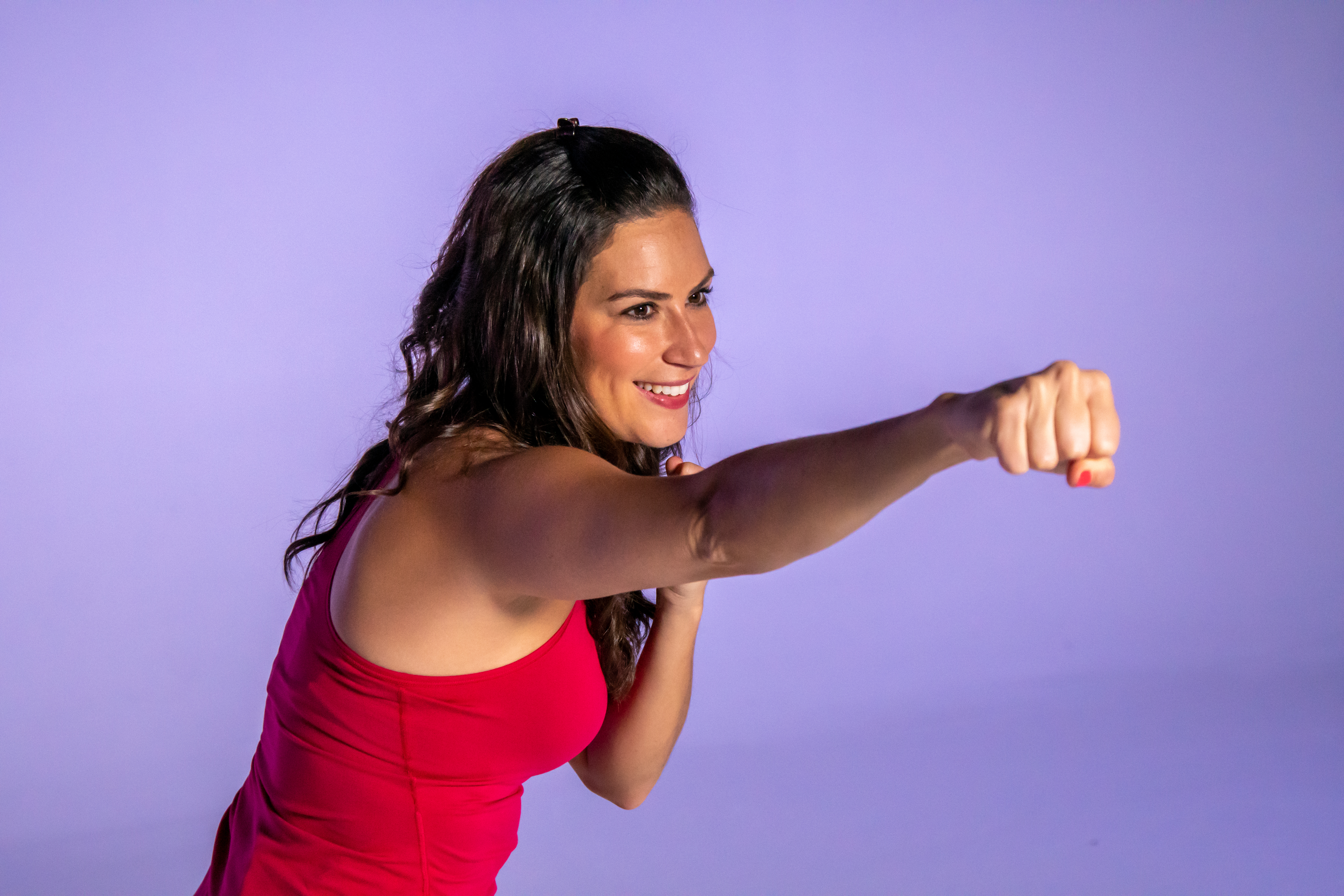 Health and fitness expert Stephanie Mansour throws a jab during kickboxing exercises. | Brian Ernst/Sun-Times