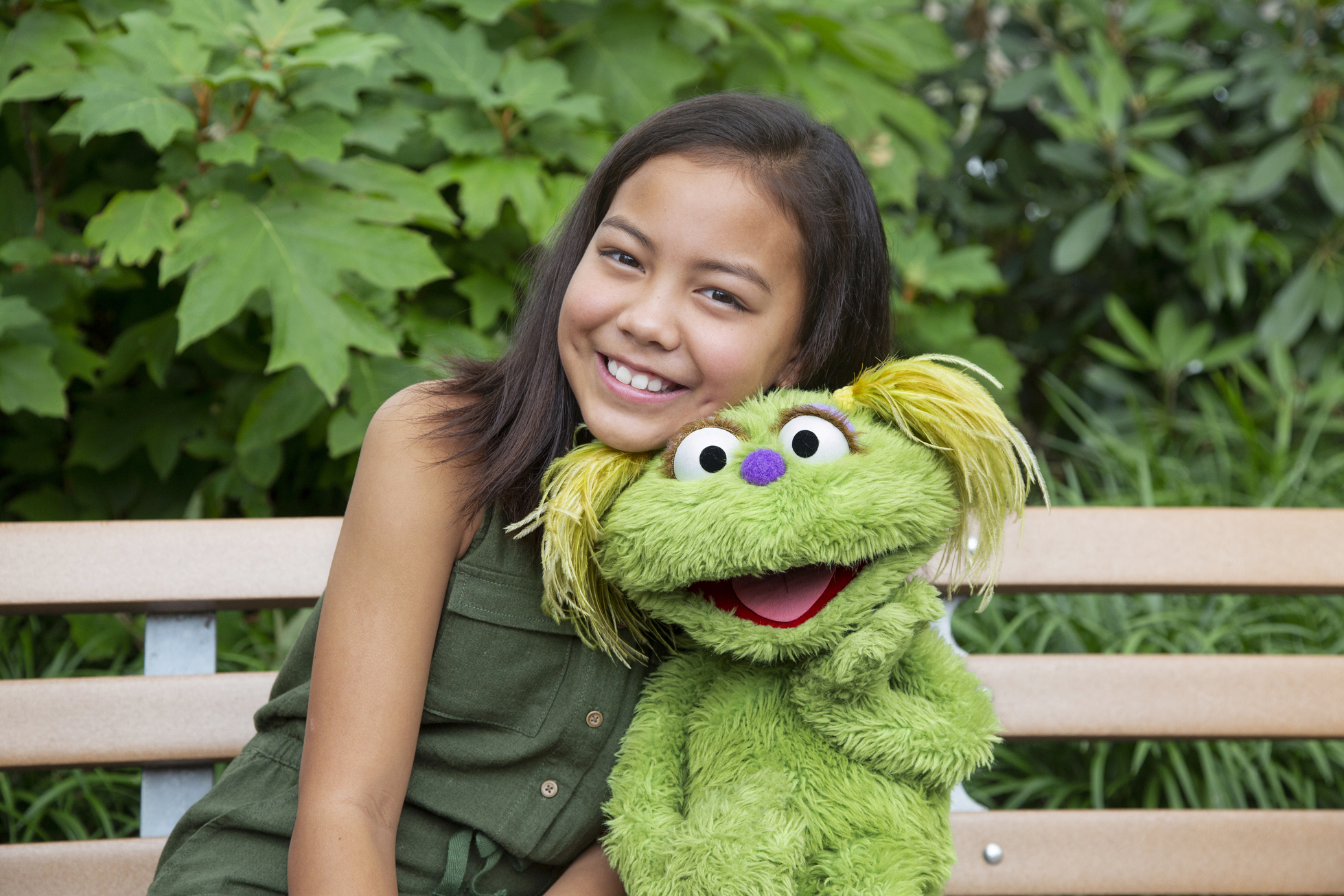 "This image released by Sesame Workshop shows 10-year-old Salia Woodbury, whose parents are in recovery, with ""Sesame Street"" character Karli. Data shows 5.7 million children under 11 live in households with a parent with substance use disorder."