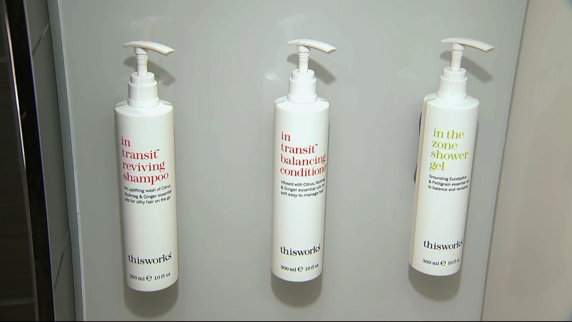 This image made from video shows bottles of shampoo, conditioner and shower gel that will replace smaller bottles of them by 2021, filmed at Marriott's headquarters in Bethesda, Maryland.