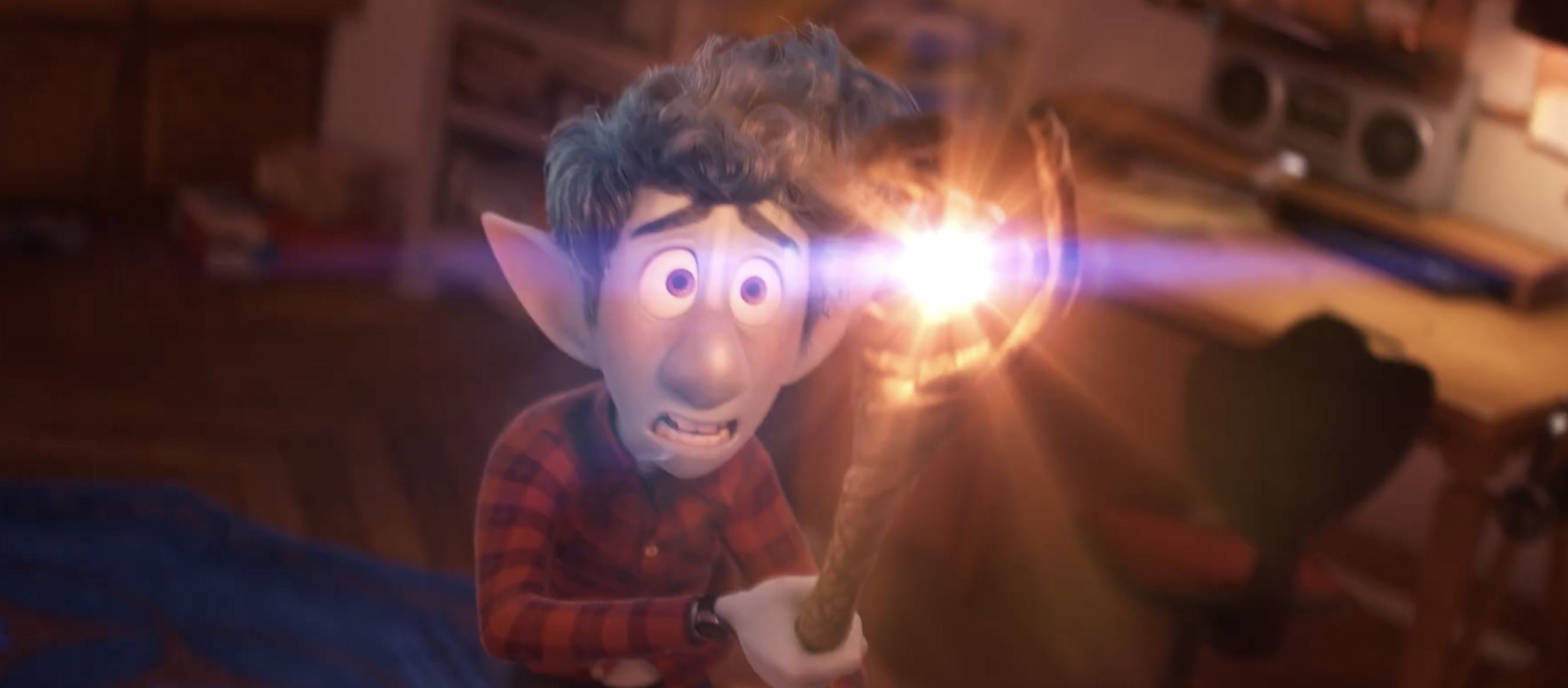 tom holland's character Ian, a scrawny blue-skinned elf, wields a magical staff