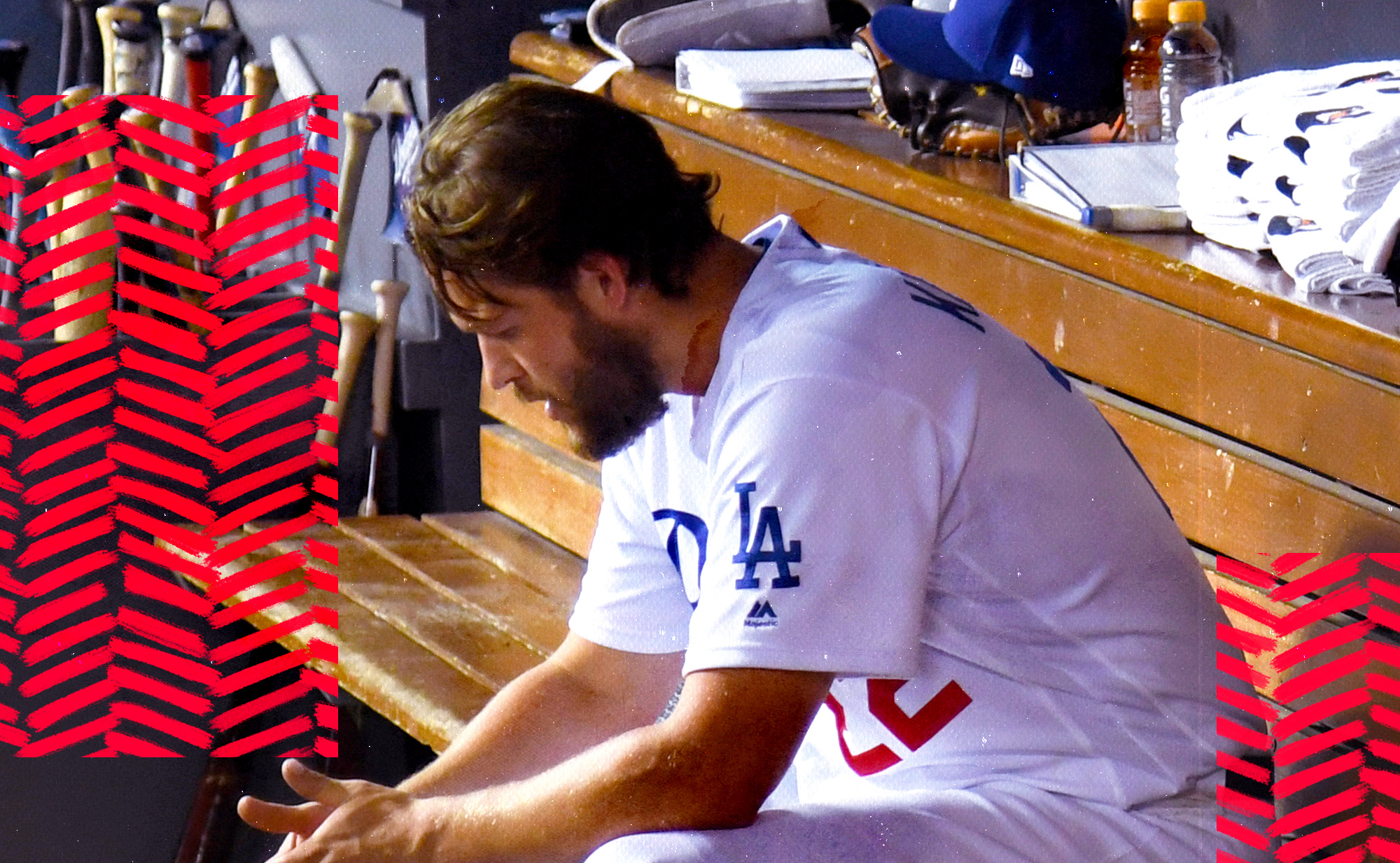 Clayton Kershaw sitting alone in the Dodgers' dugout after losing Game 5 of the NLDS