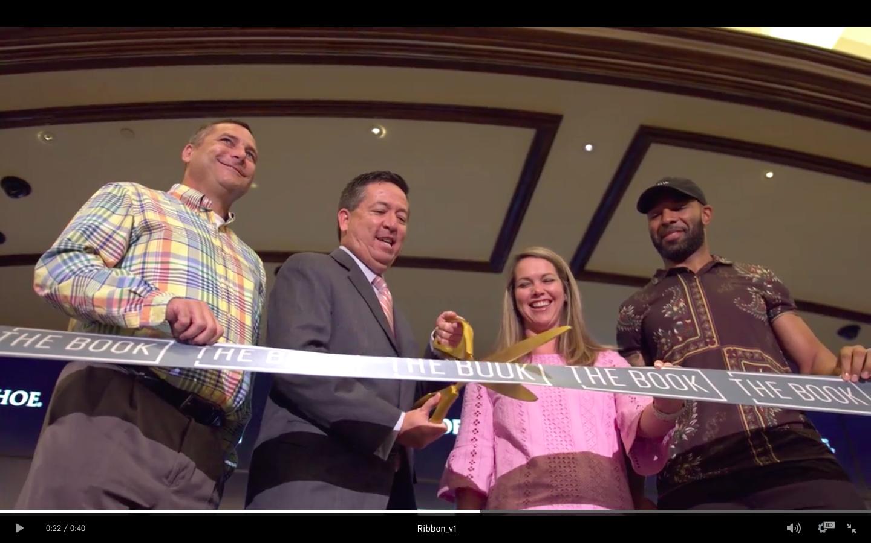 "Former Bears running back Matt Forte (far right) helps open ""The Book"" at the Horseshoe Hammond Casino."