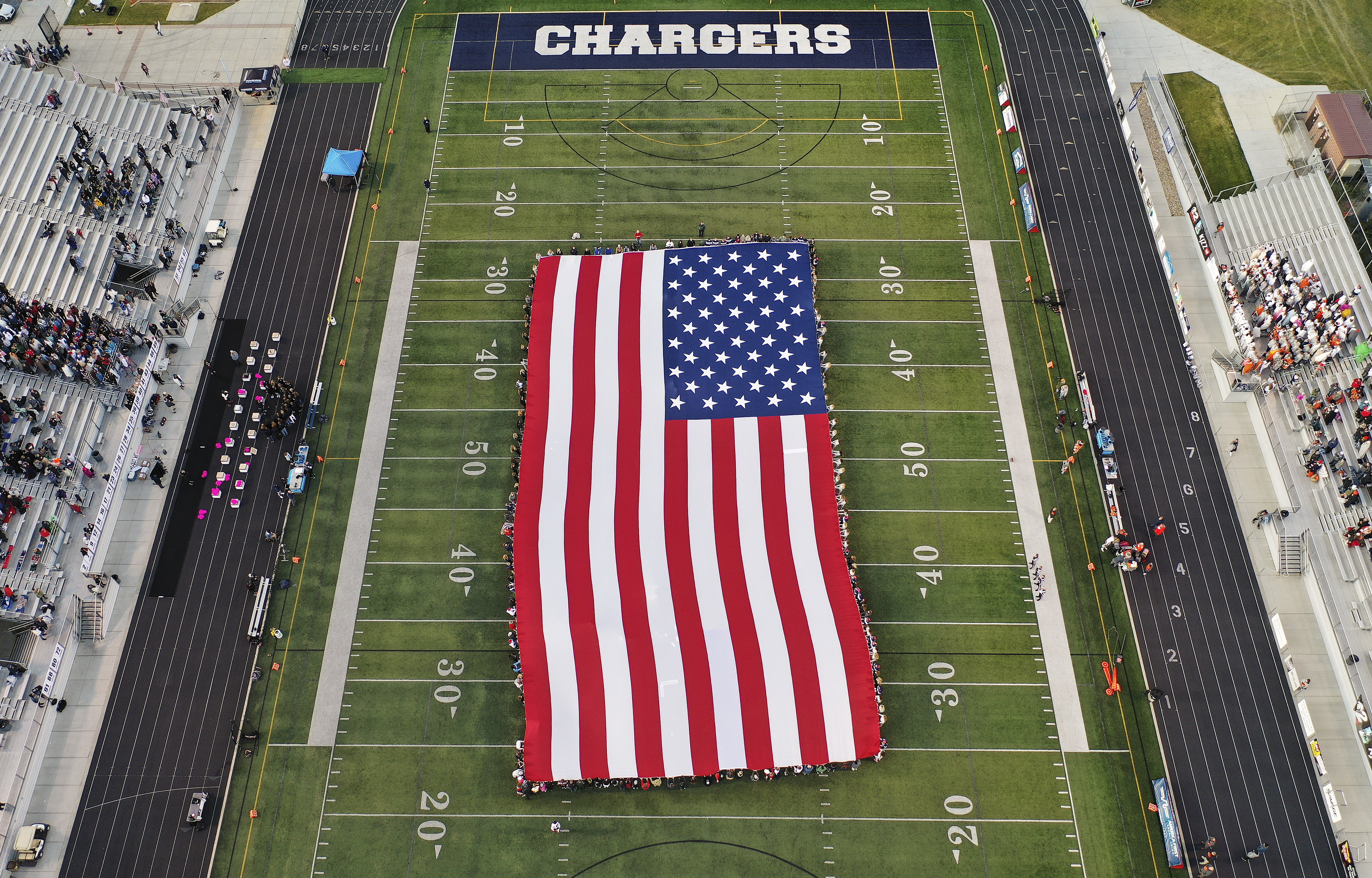 Local veterans and currently serving military members are honored during a flag ceremony at Corner Canyon High School in Draper on Thursday, Oct. 10, 2019.