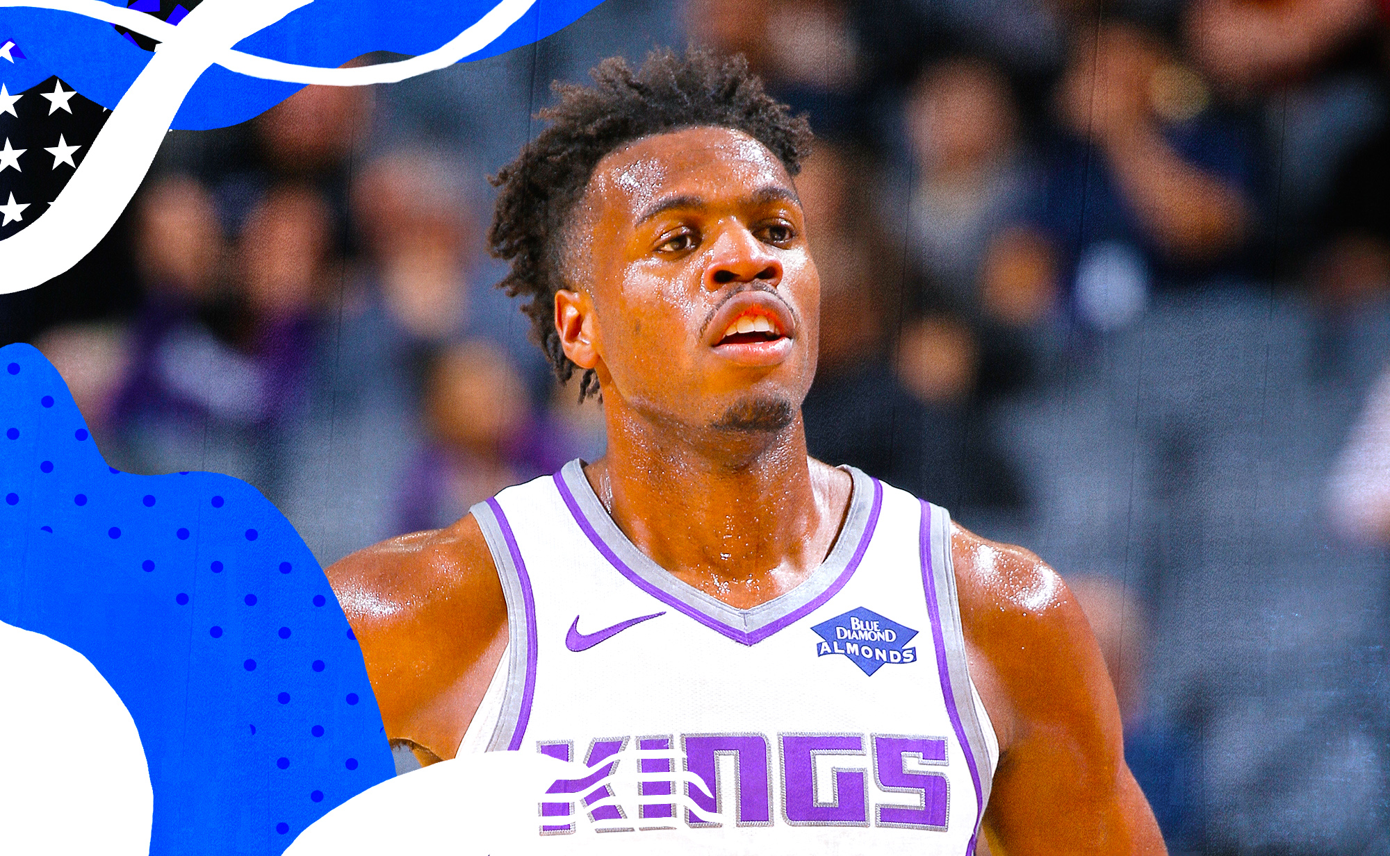 Buddy Hield of the Kings focuses on the court.
