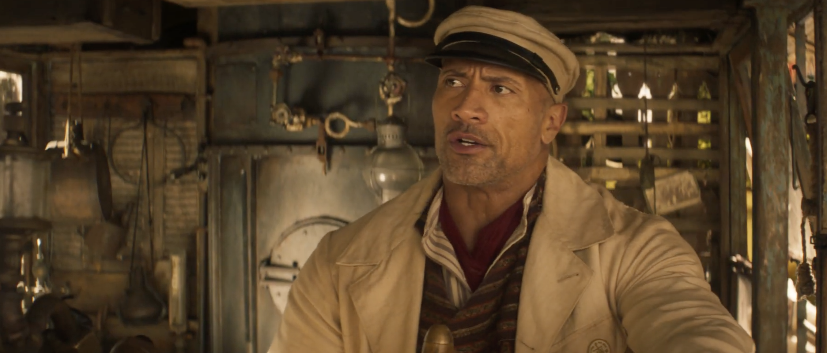 dwayne the rock johnson in a smoldering hot jungle cruise skipper uniform