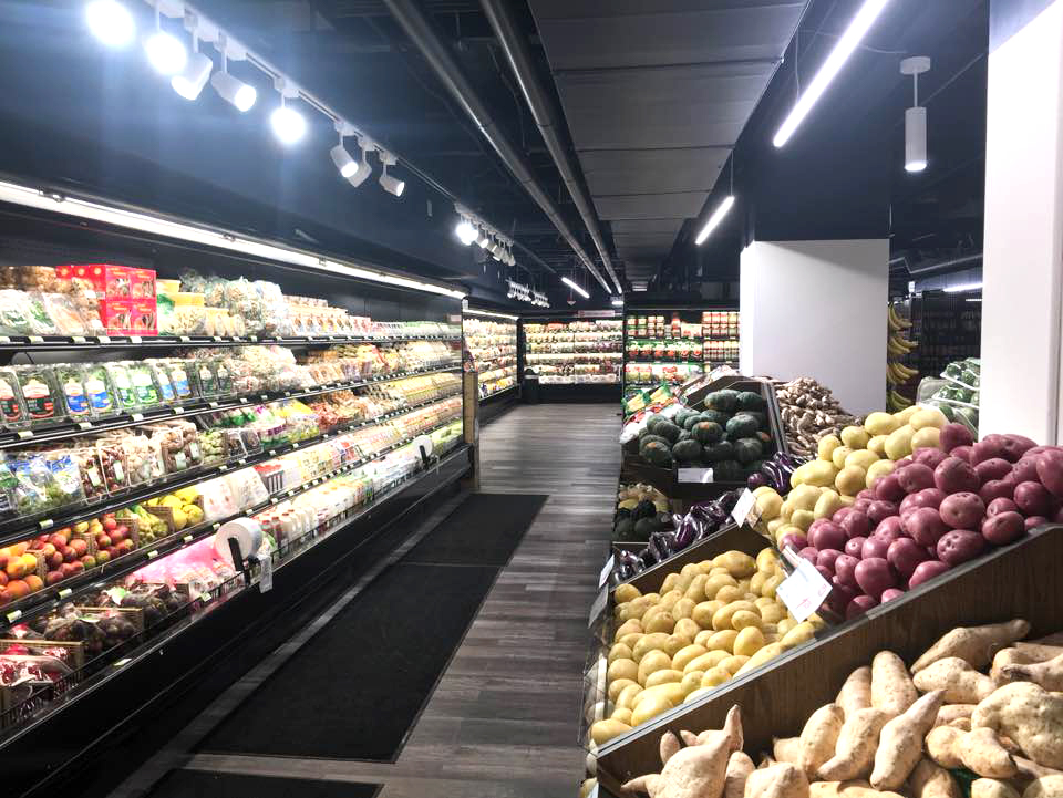 Store shelves at H Mart's new Pike Place-adjacent location, stocked with produce and other goods.