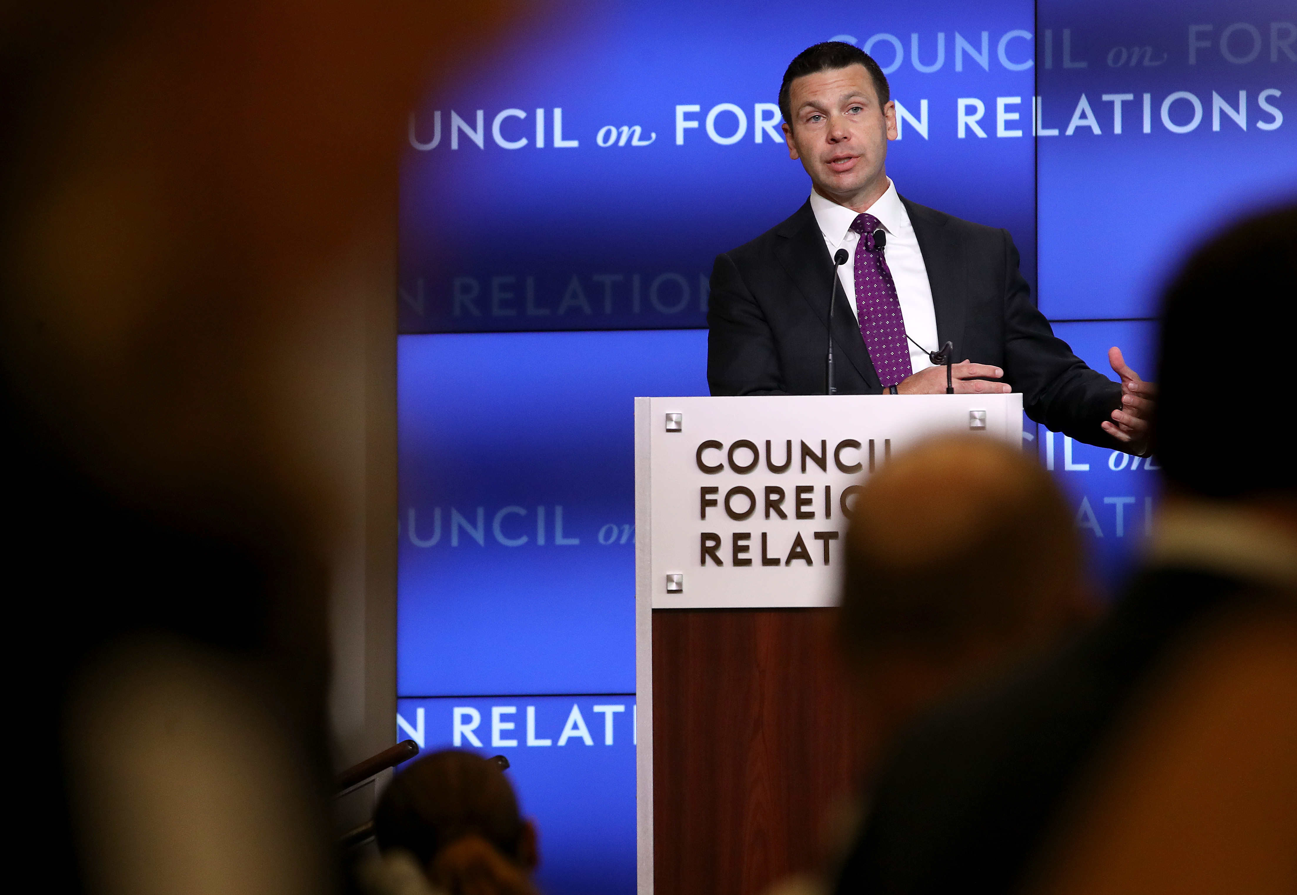 Acting Homeland Security Secretary Kevin McAleenan speaking from a podium at the Council on Foreign Relations.