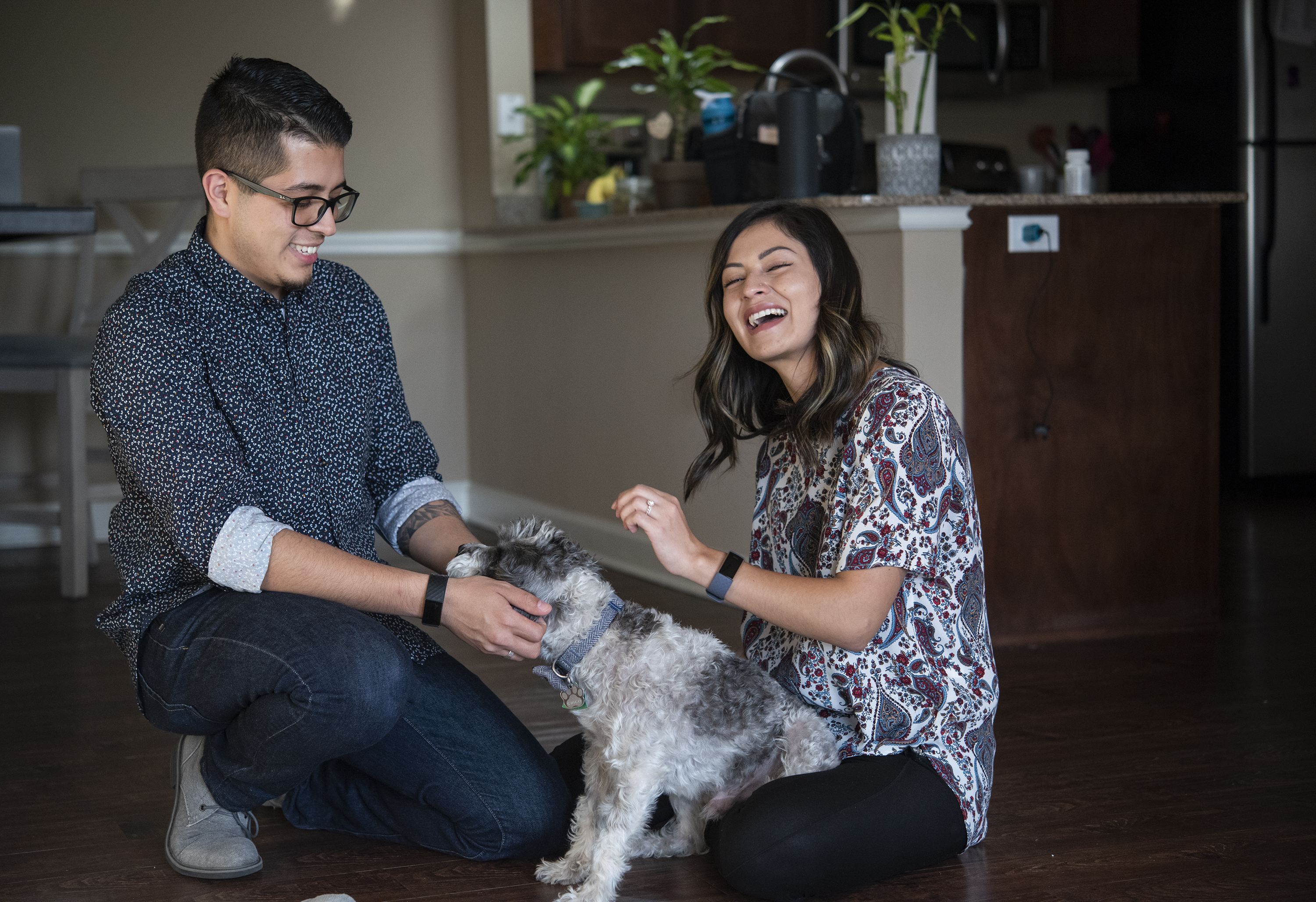 Emmanuel Diaz and Yisarai Valbuena Sanchez play with their new dog Chico at their apartment in Tyler, Texas, on Thursday, Oct. 10, 2019. The couple are both DACA recipients and moved to Tyler from Salt Lake City in June.