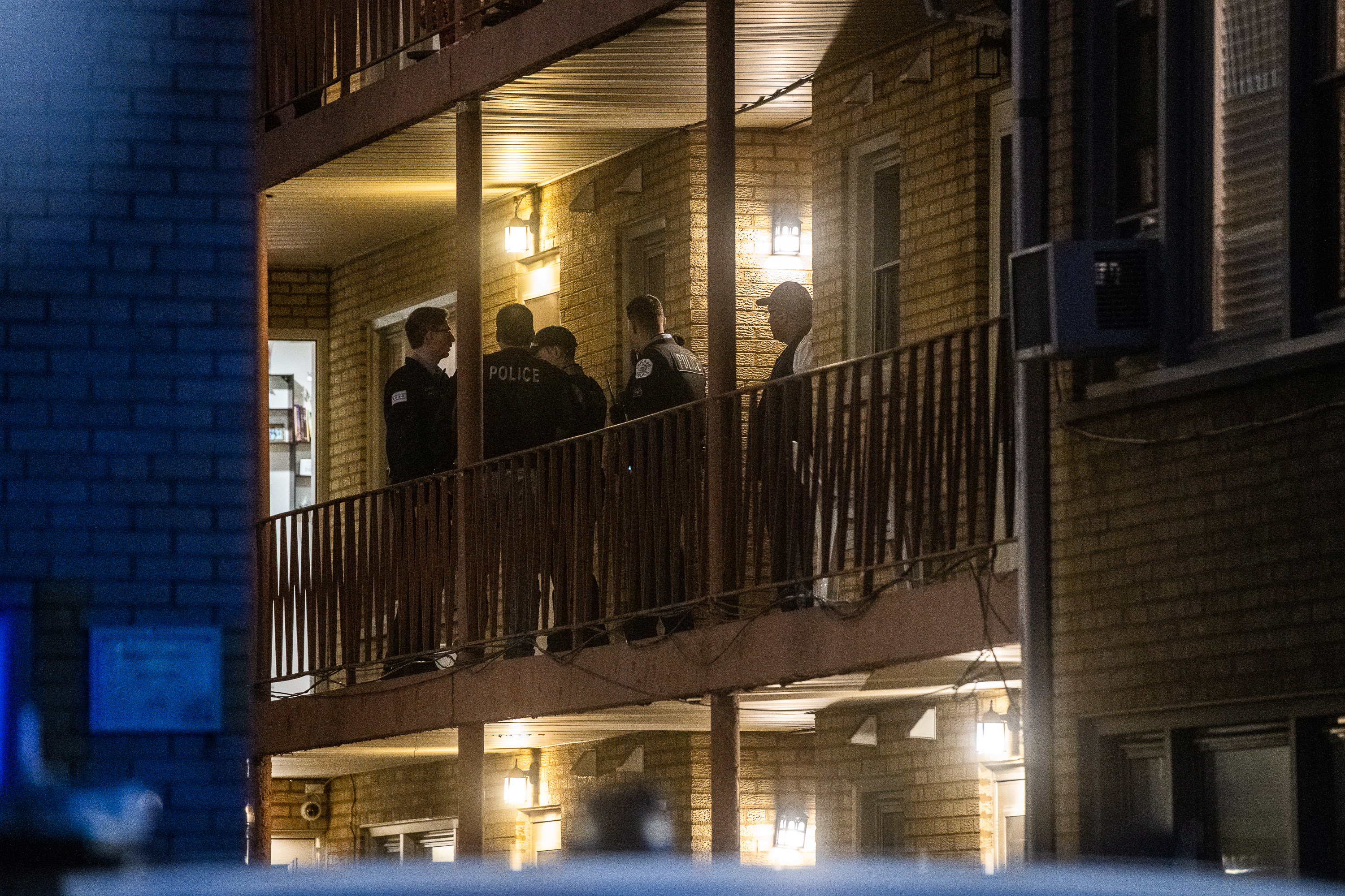 Chicago police investigate a shooting that left five people dead Saturday at a condo complex in the 6700 block of West Irving Park Road.