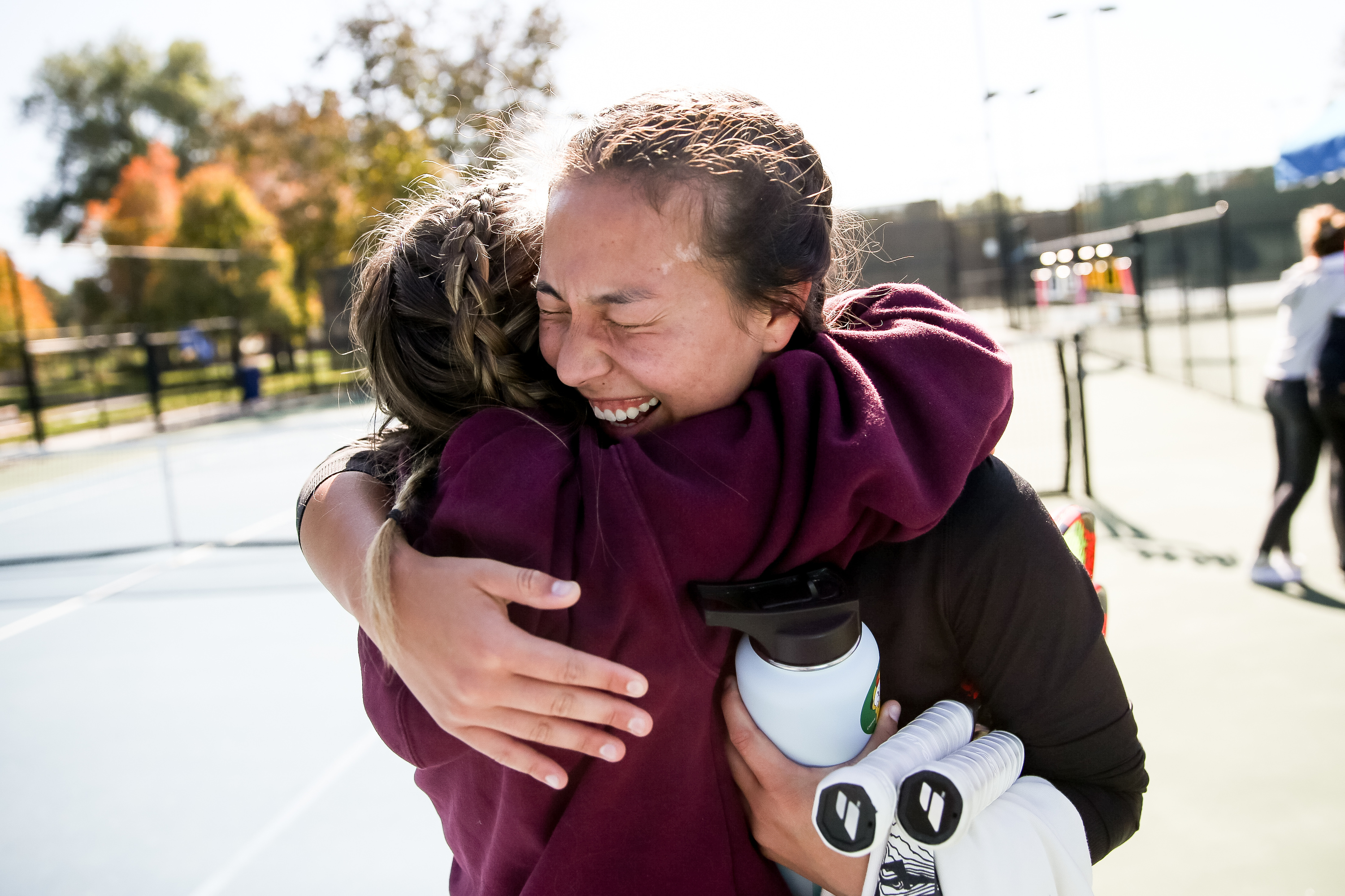 Naomi Noot, of American Heritage Academy, hugs friend Gentry McClain after beating Manti's Sadie Cox in the 3A first singles match of the girls tennis state championship at Liberty Park in Salt Lake City on Saturday, Oct. 12, 2019.