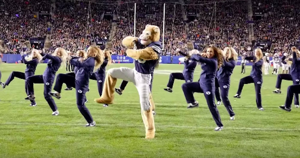 Cosmo the Cougar, performed by Charlie Bird, leads BYU's dance team in a spirited routine. His dance made the top of ESPN Top 10 Mascot Moments of All-Time in College Football.