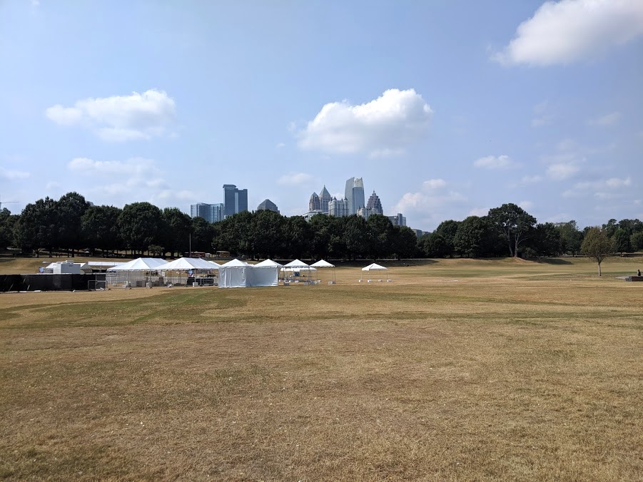 A dry-looking plain at Piedmont Park, with the city skyline in the background.