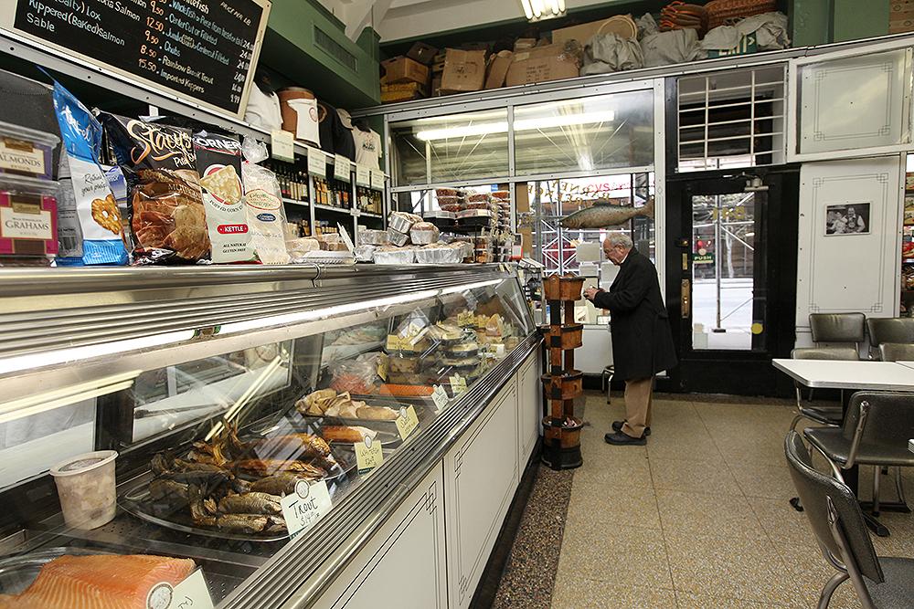 A man stands at the fish counter at Barney Greengrass