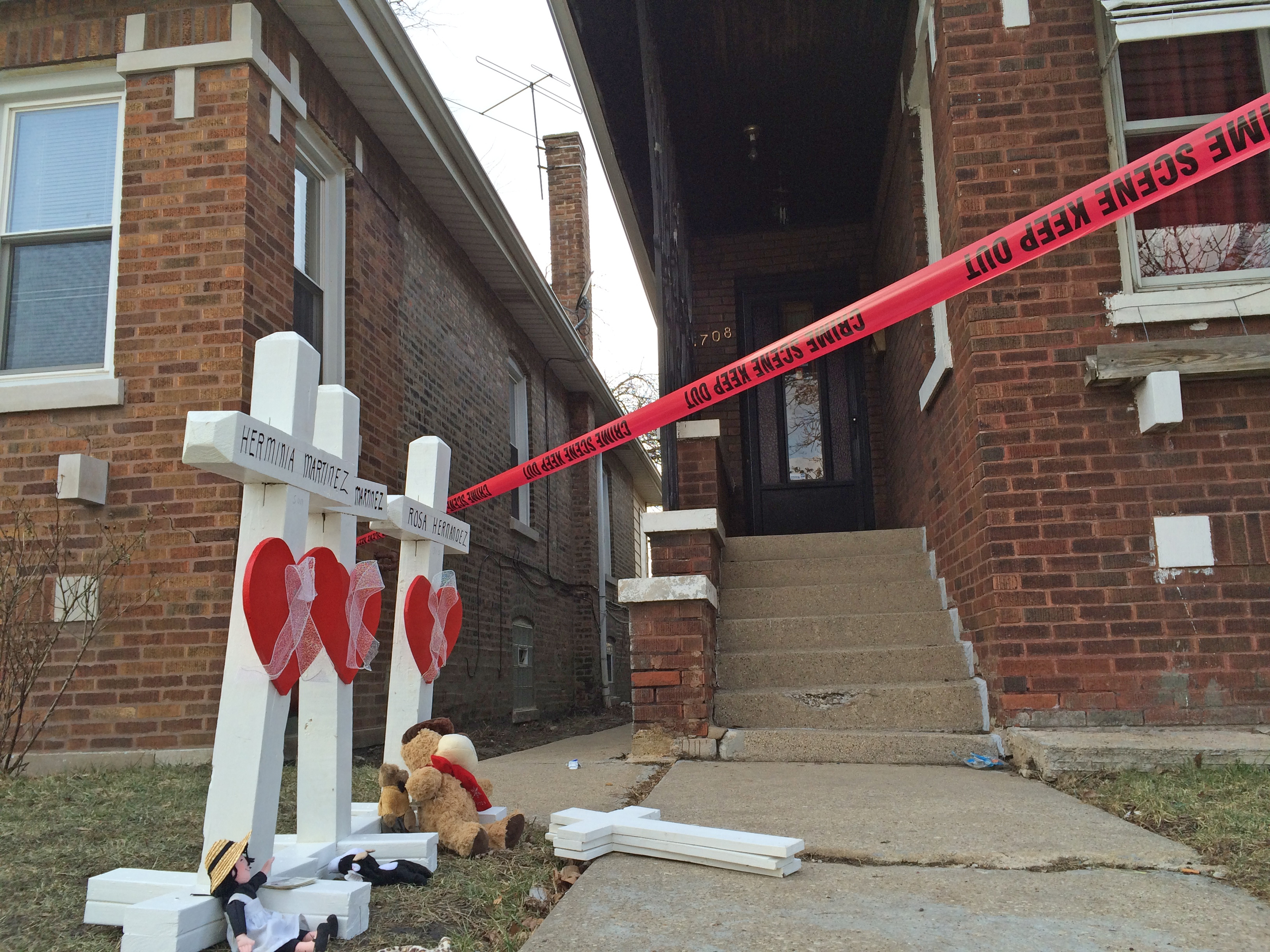 Crosses in front of a home where six people, including two children, were killed in Gage Park in 2016.