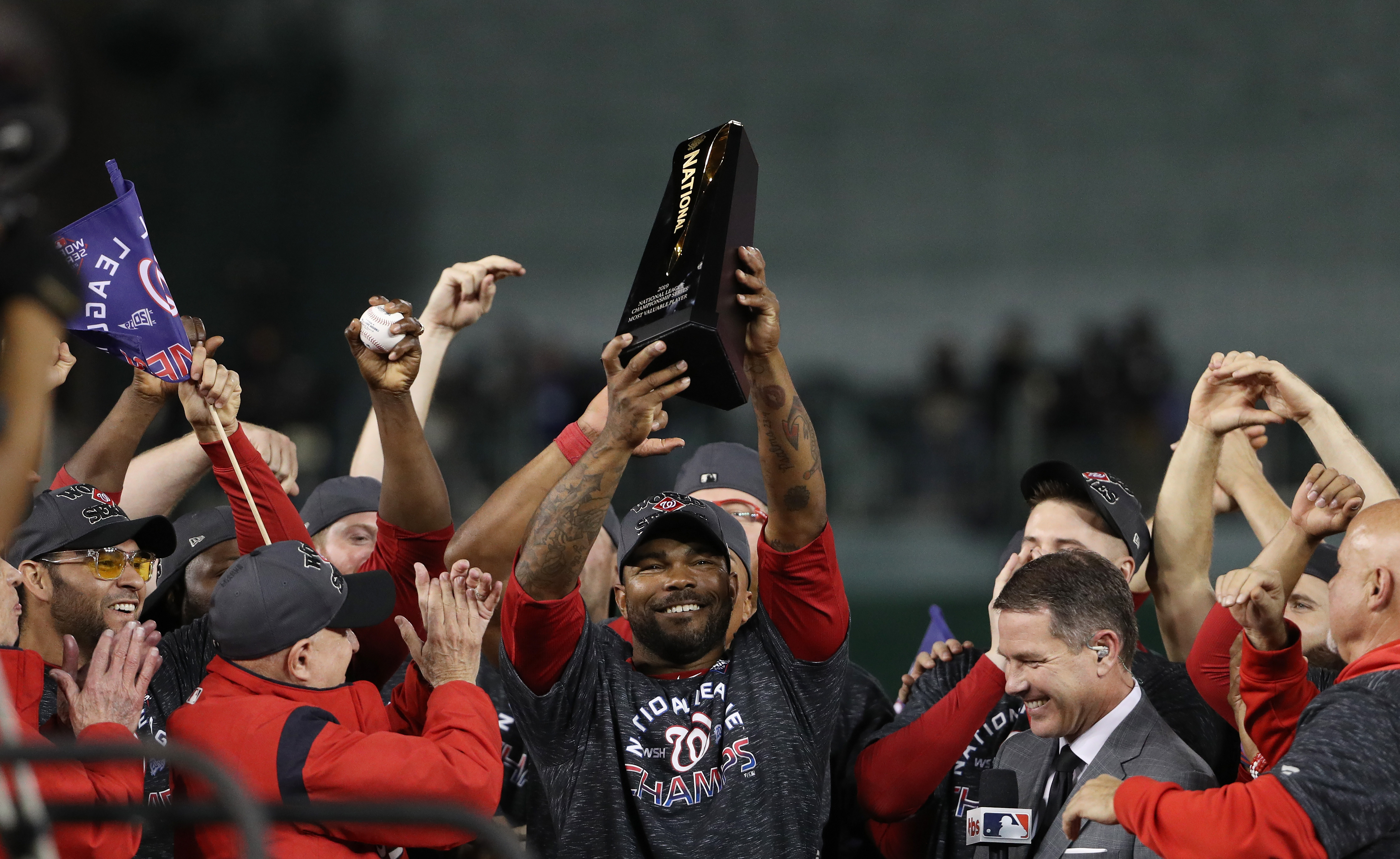 Howie Kendrick holds up the NLCS MVP trophy