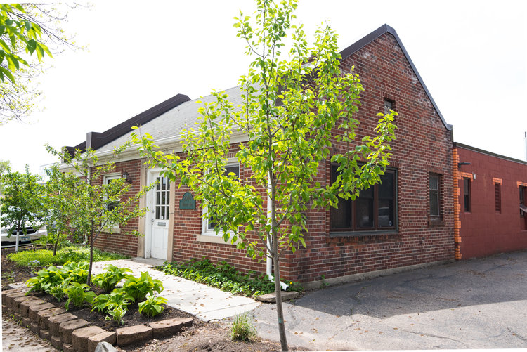 The brick exterior of the new cafe