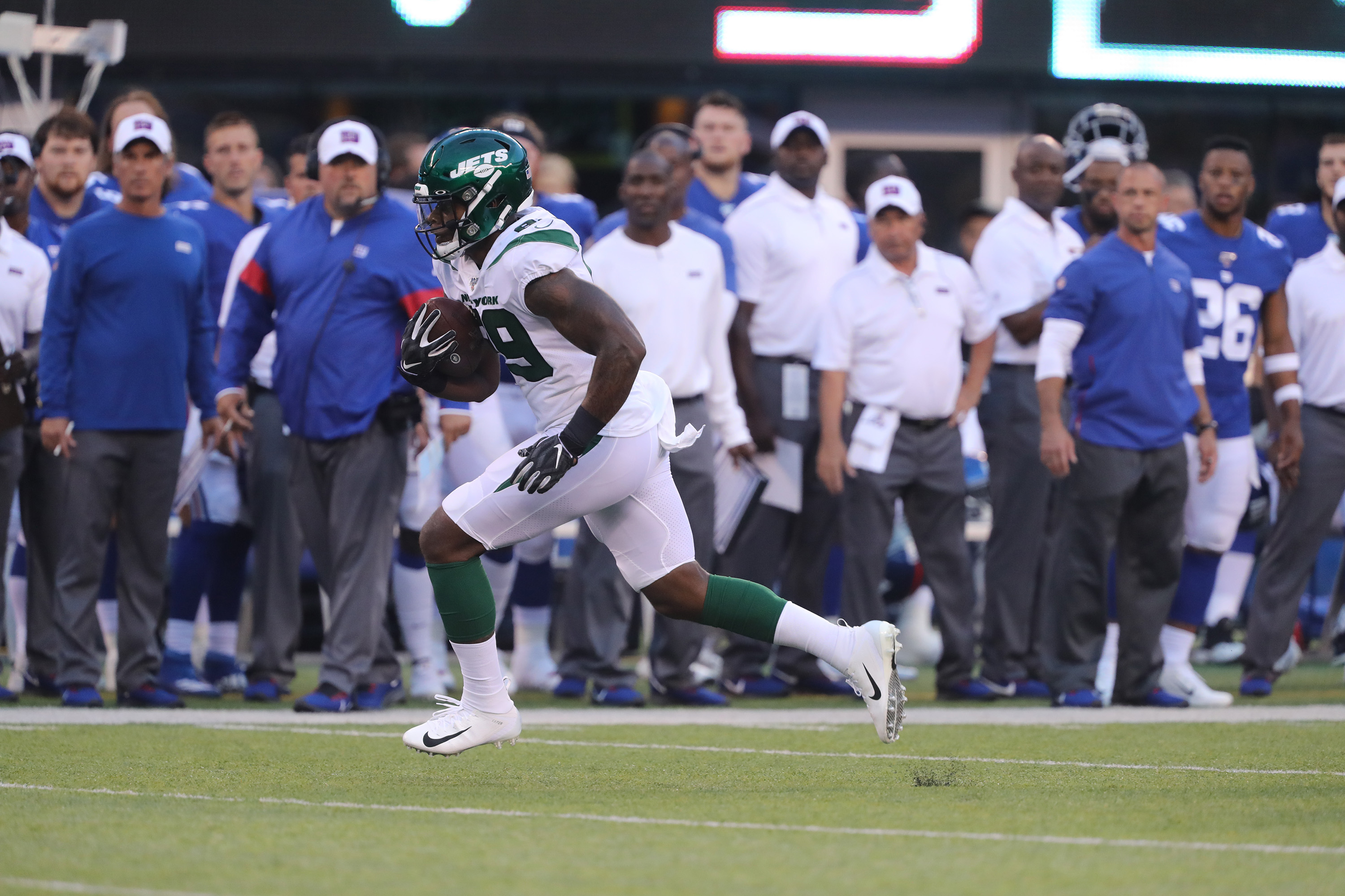 Tight End Chris Herndon of the New York Jets in action against the New York Giants during their Preseason game at MetLife Stadium on August 08, 2019 in East Rutherford, New Jersey.