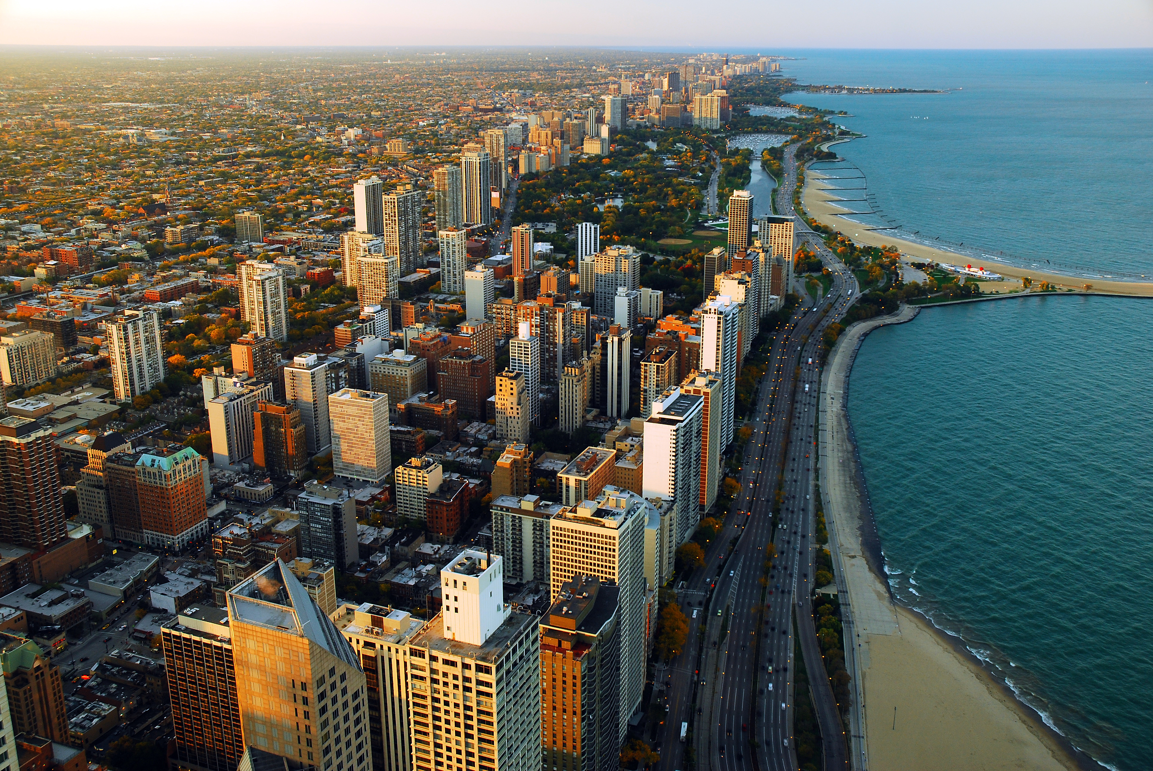 An aerial shot of Chicago buildings and the lake shore.