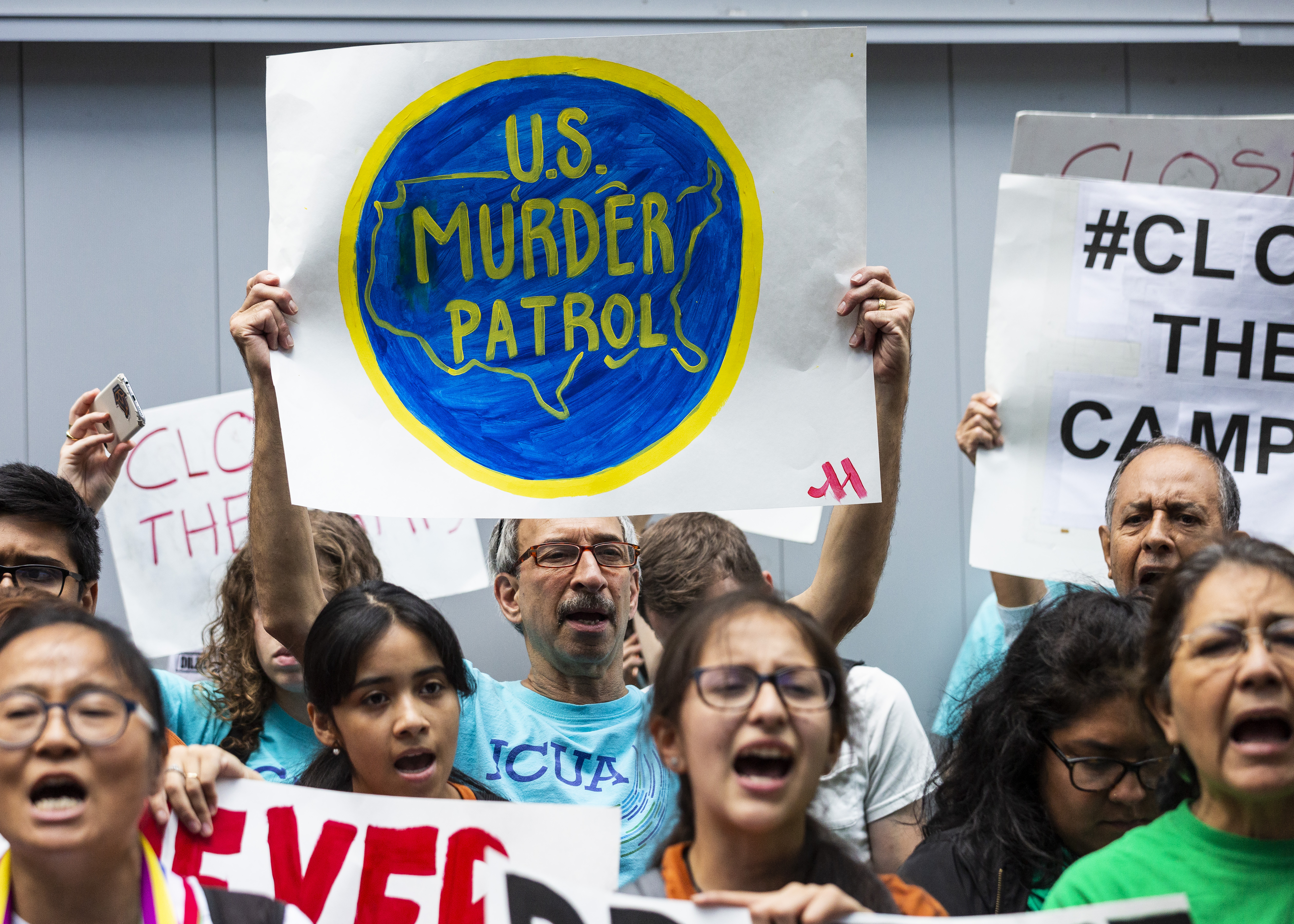 Immigrant rights activists protest outside the Marriott Marquis Chicago.