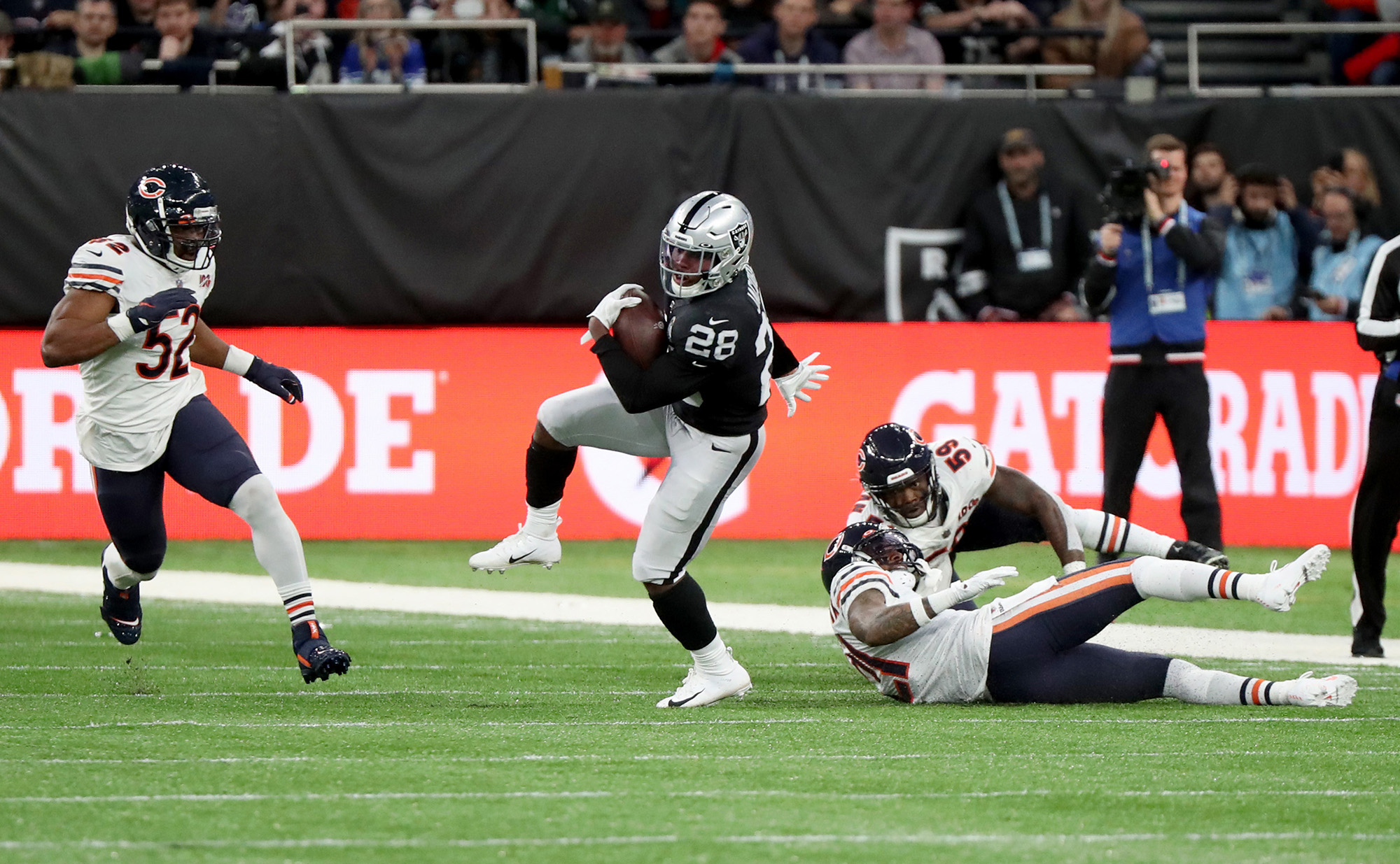 Oakland Raiders running back Josh Jacobs breaks free from the Chicago Bears defense in the first quarter against the Oakland Raiders on October 6, 2019, at Tottenham Hotspur Stadium in London.
