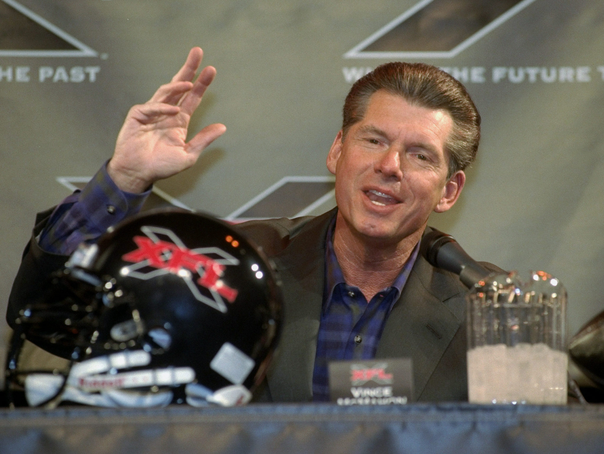World Wrestling Federation chairman Vince McMahon speaks to the media to announce the creation of the XFL, a new professional football league.
