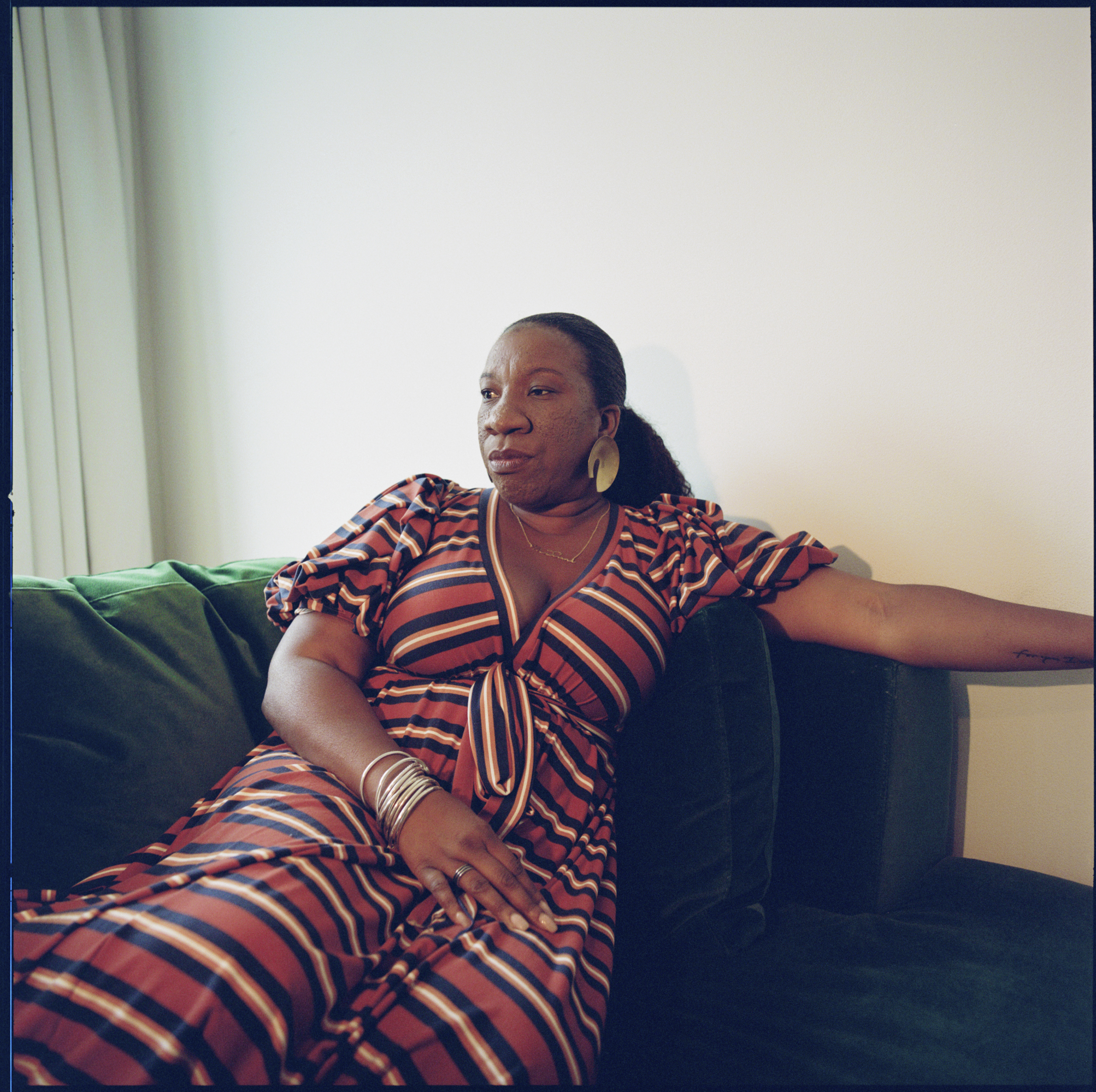 Tarana Burke, the founder of the MeToo movement, sitting on a couch in her house.