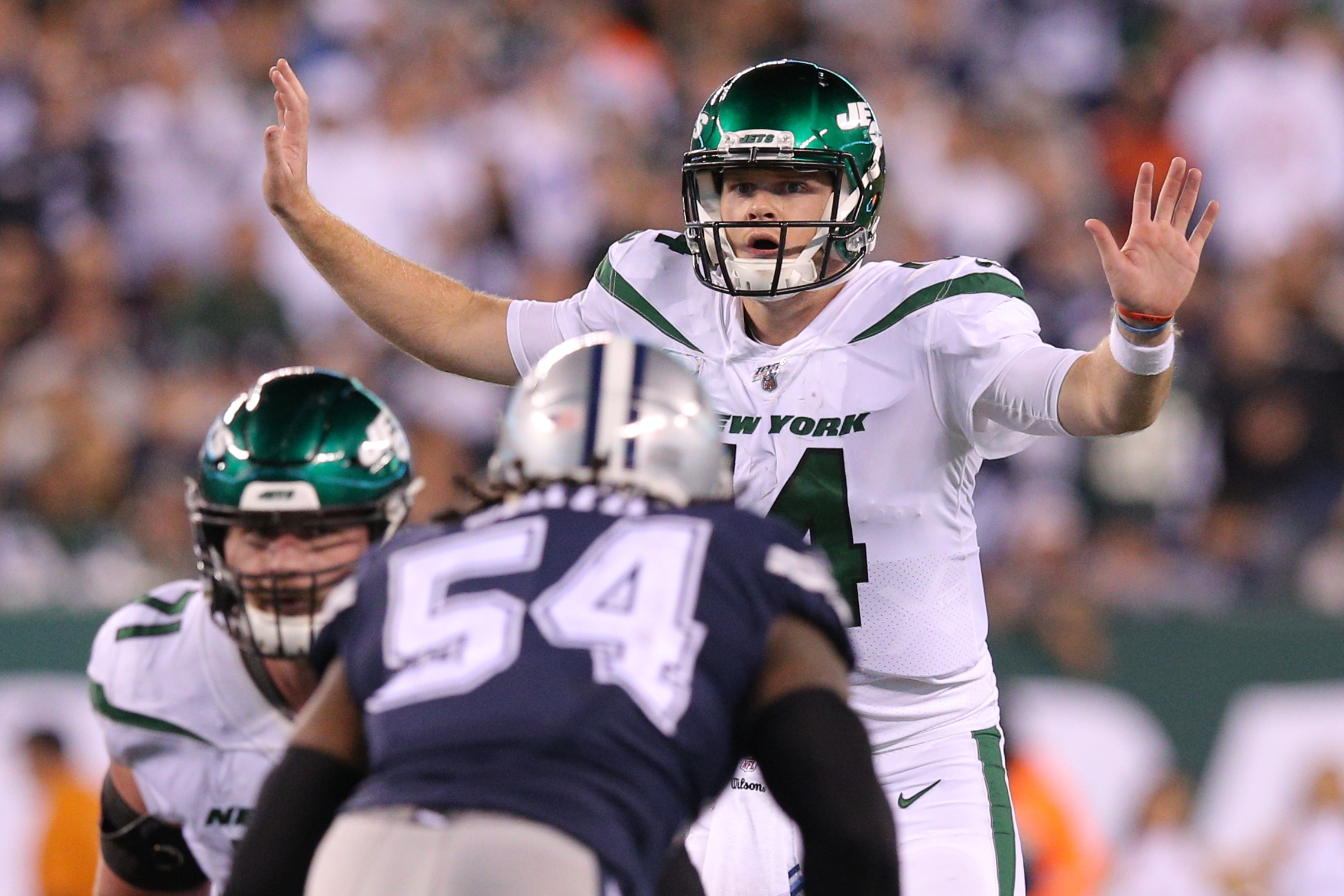 New York Jets quarterback Sam Darnold calls a play against the Dallas Cowboys during the fourth quarter at MetLife Stadium.
