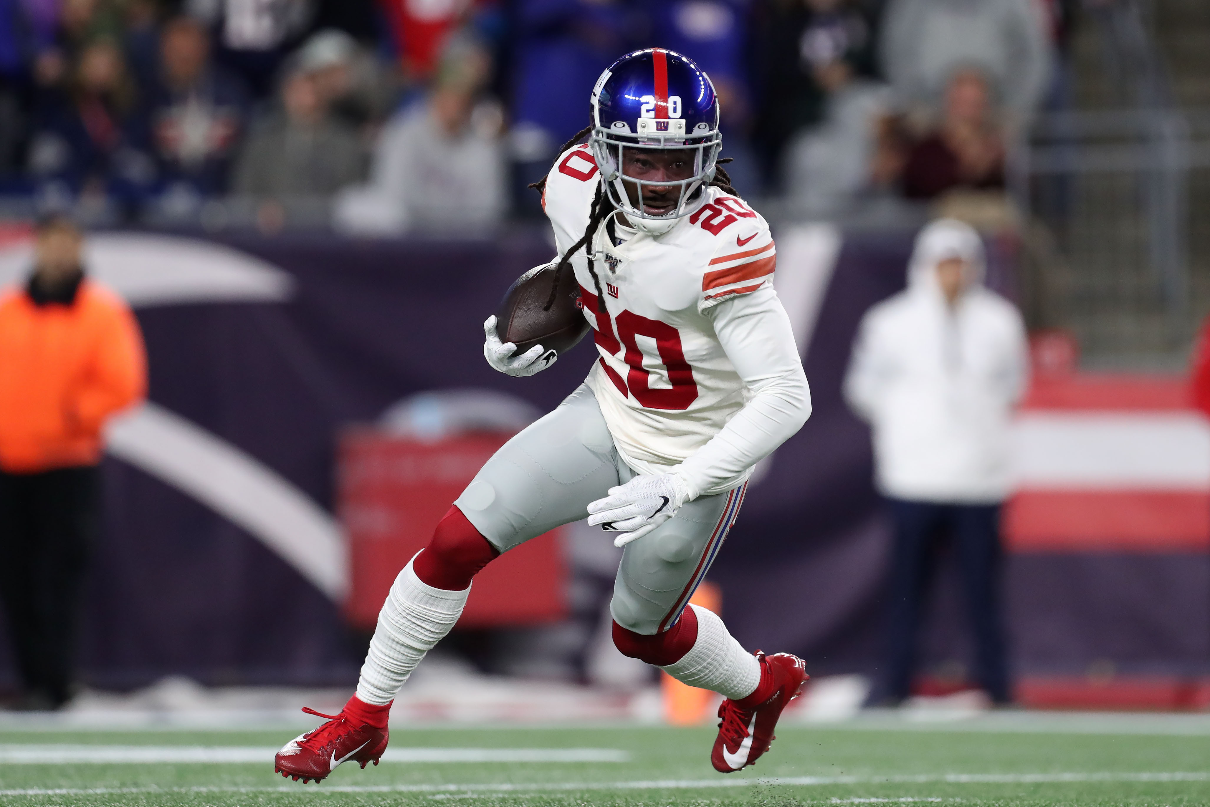 New York Giants cornerback Janoris Jenkins runs with the ball after intercepting a pass from the New England Patriots during the first half at Gillette Stadium.